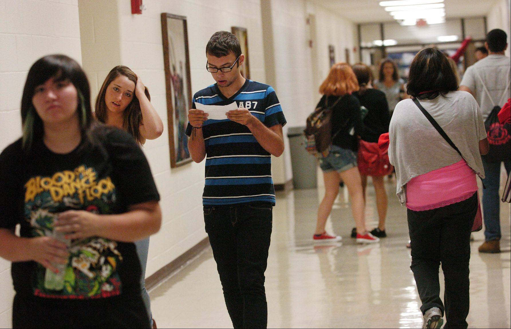 Students find their way to the first classes on the first day of school at Grant High School in Fox Lake.