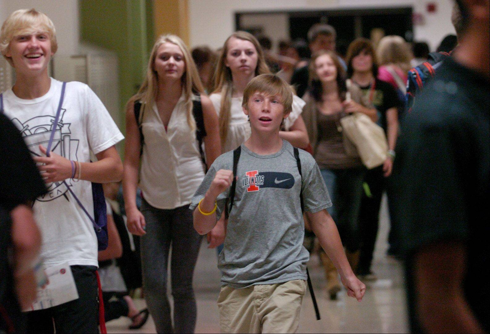 Freshman Christian Kanzler makes his way to class Wednesday at Grant High School in Fox Lake.