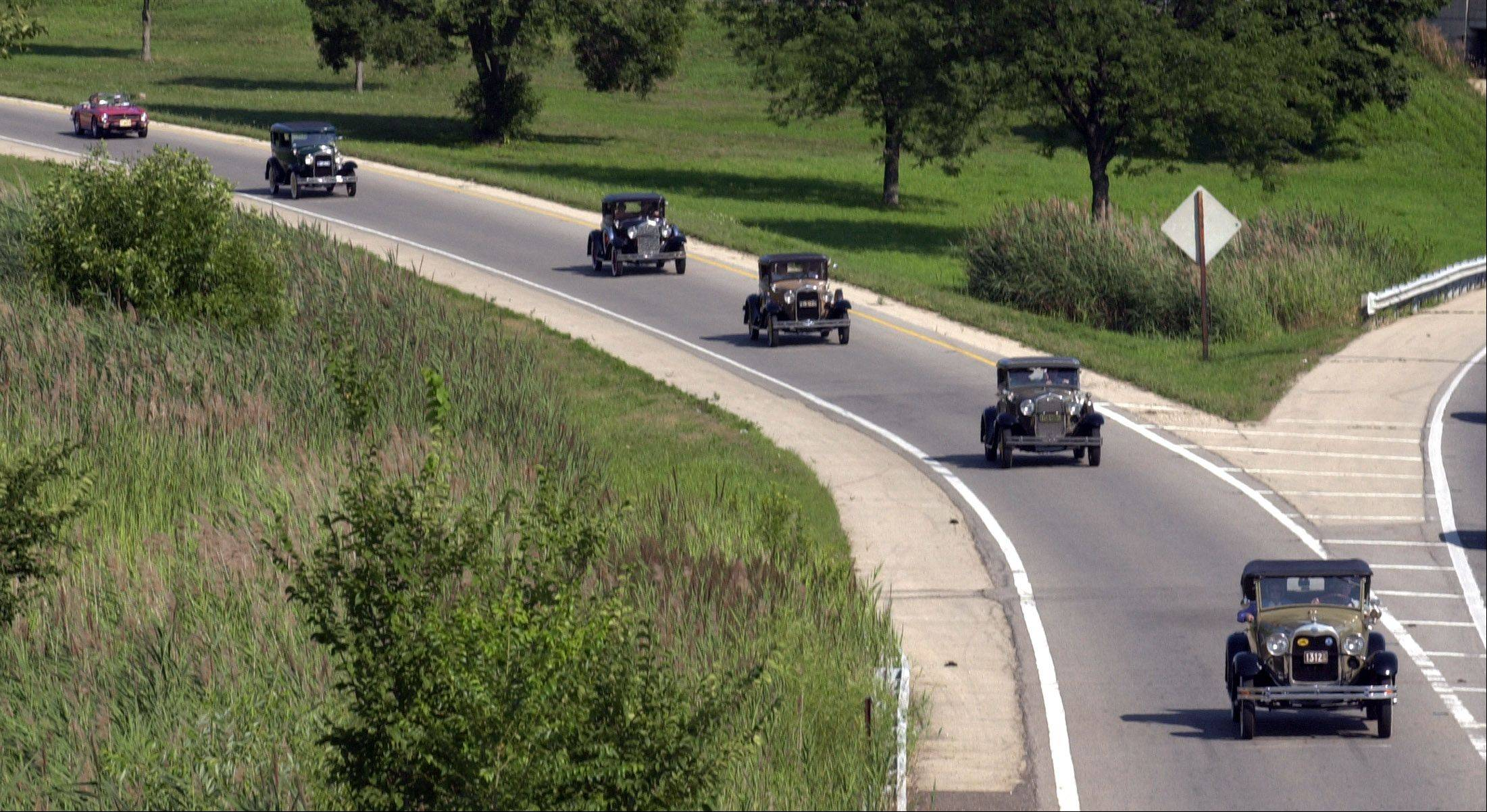 ... and now. This year's race will be held at 3:30 p.m. Saturday, Aug. 18, along Larkin Avenue and will feature vintage cars.