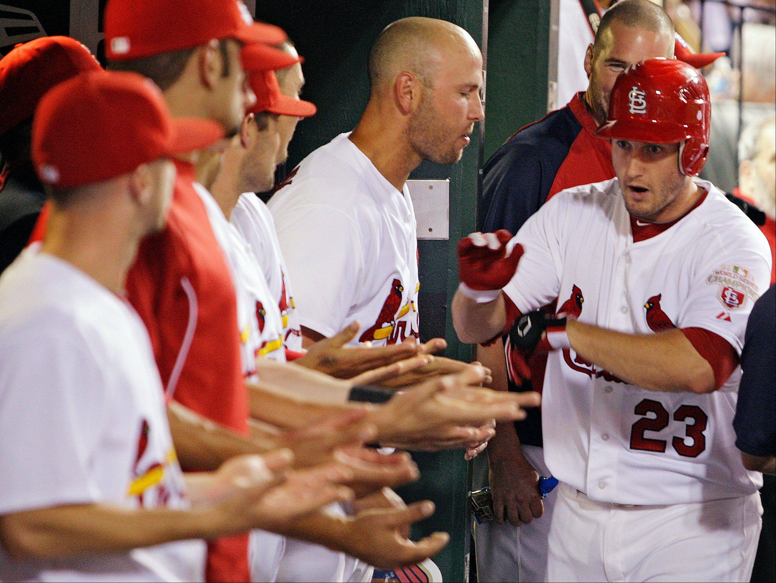 St. Louis Cardinals third baseman David Freese celebrates in the dugout Wednesday after hitting a two-run home run in the fourth inning against the Arizona Diamondbacks.