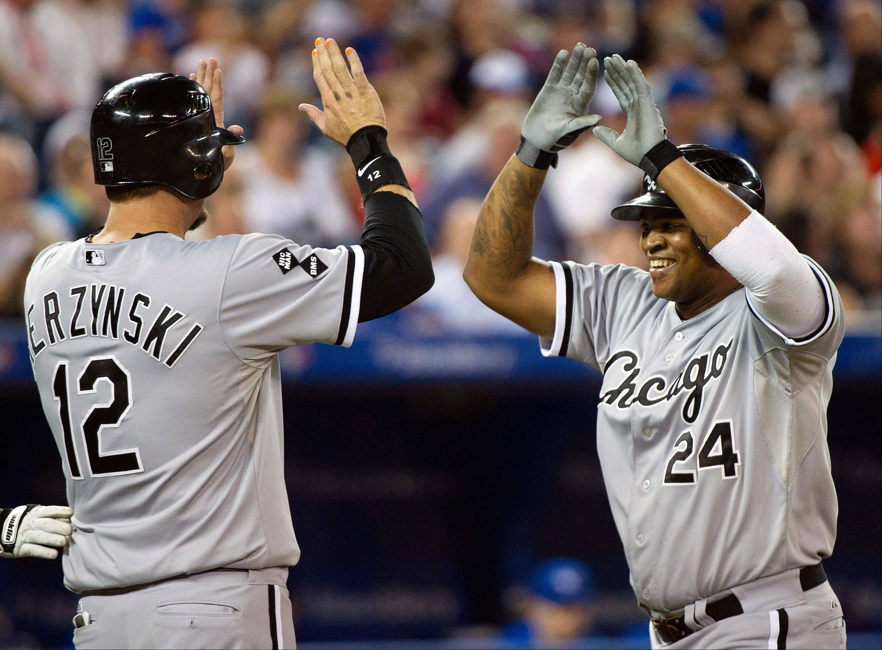 White Sox designated-hitter Dayan Viciedo, right, celebrates his solo home run with teammate A.J. Pierzynski, left, while playing against the Toronto Blue Jays Wednesday during the seventh inning.