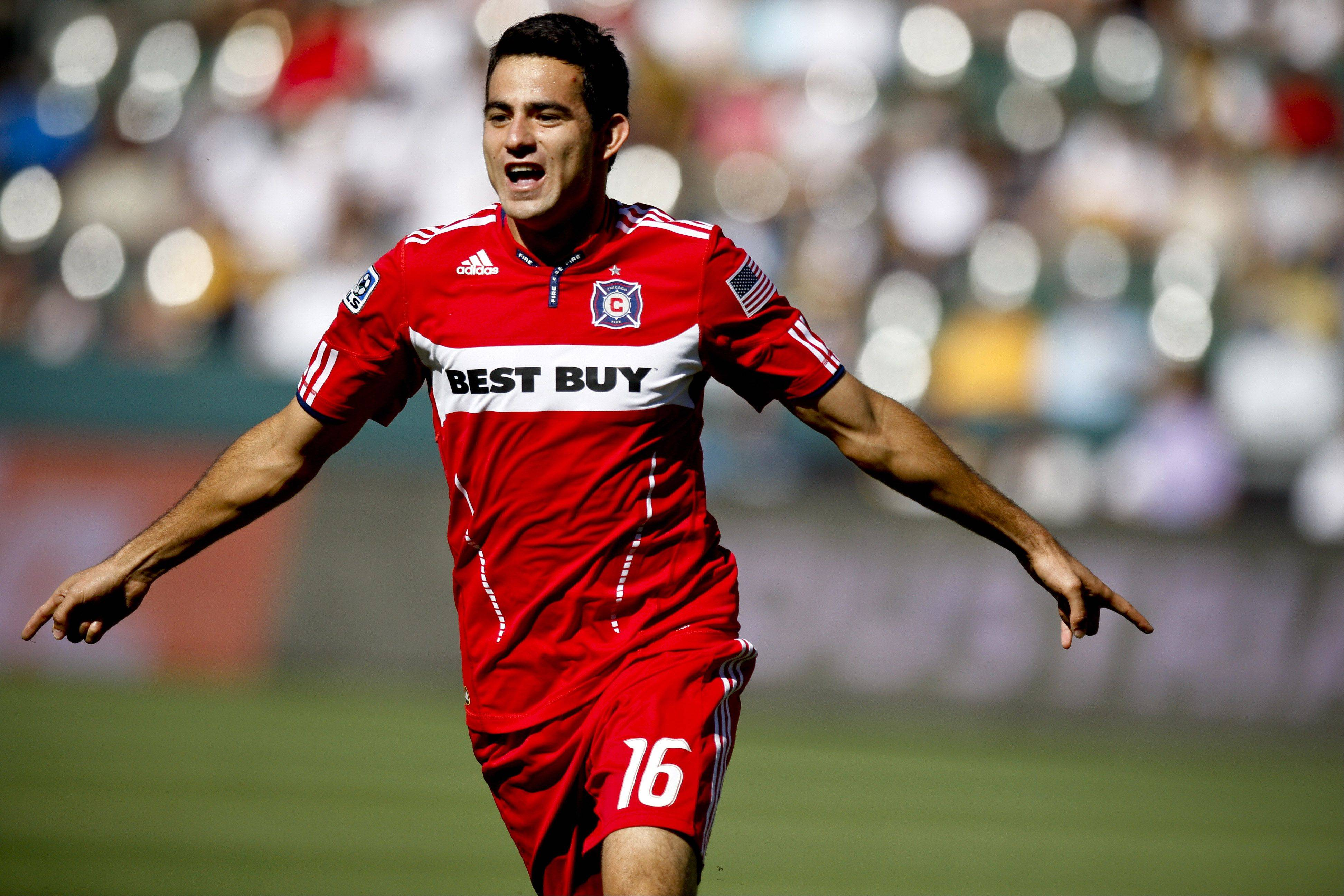 Chicago Fire midfielder Marco Pappa celebrates scoring against the Los Angeles Galaxy during the first half of their MLS soccer match, Sunday, Aug. 1, 2010, in Carson, Calif.