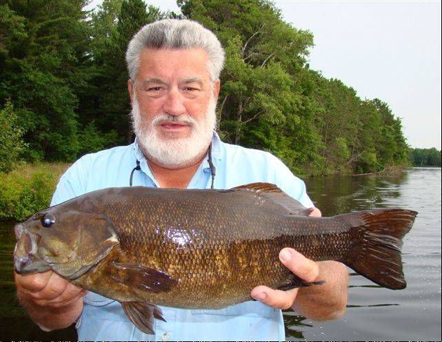 Mike Mladenik displays the super-sized smallmouth bass availalble on the Menominee River in the Crivitz, Wis., area.