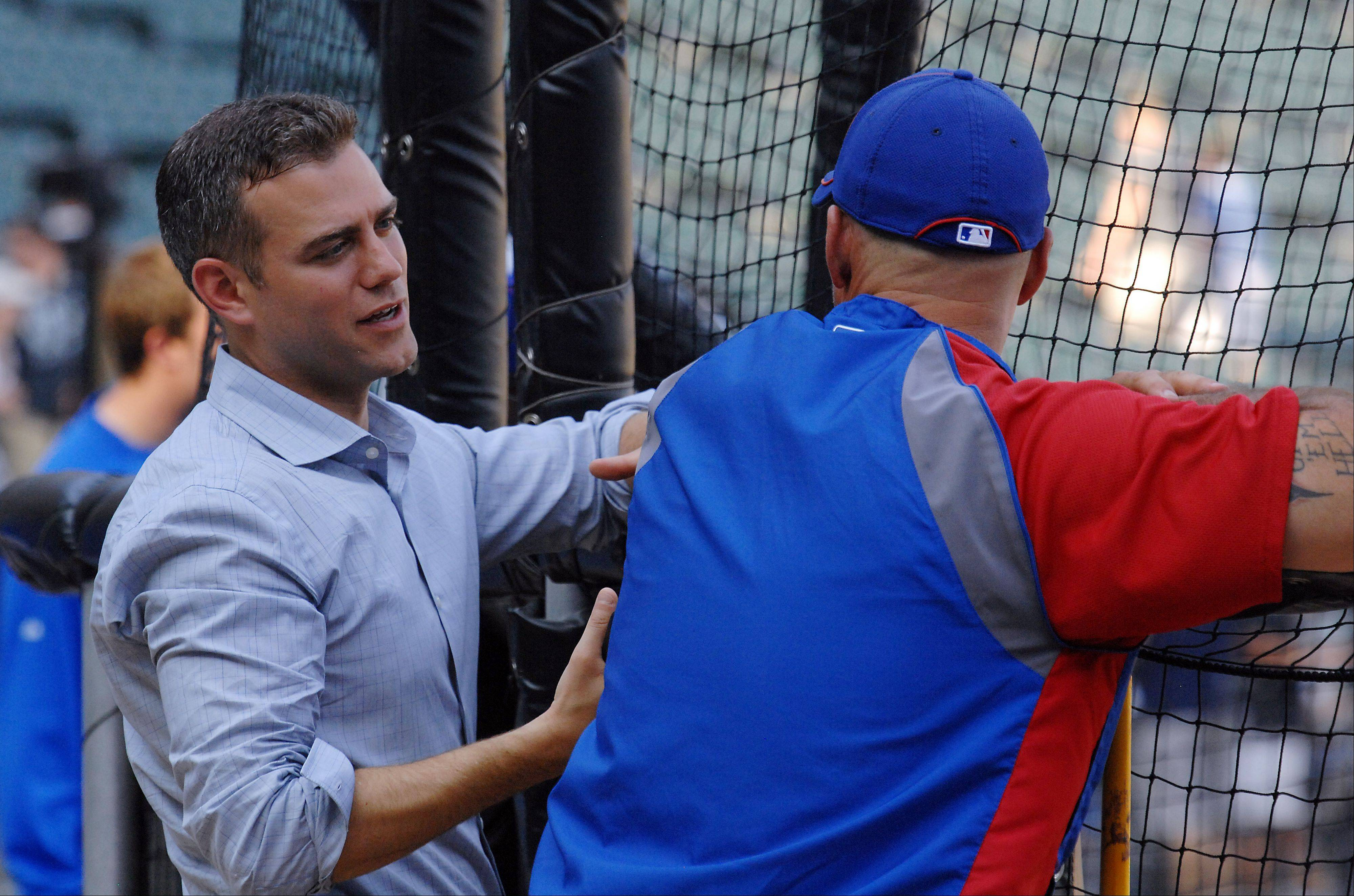 Cubs' president of baseball operations Theo Epstein talks with Cubs manager Dale Sveum before the crosstown classic. Epstein fired minor-league and player-development guru Oneri Fleita on Wednesday.