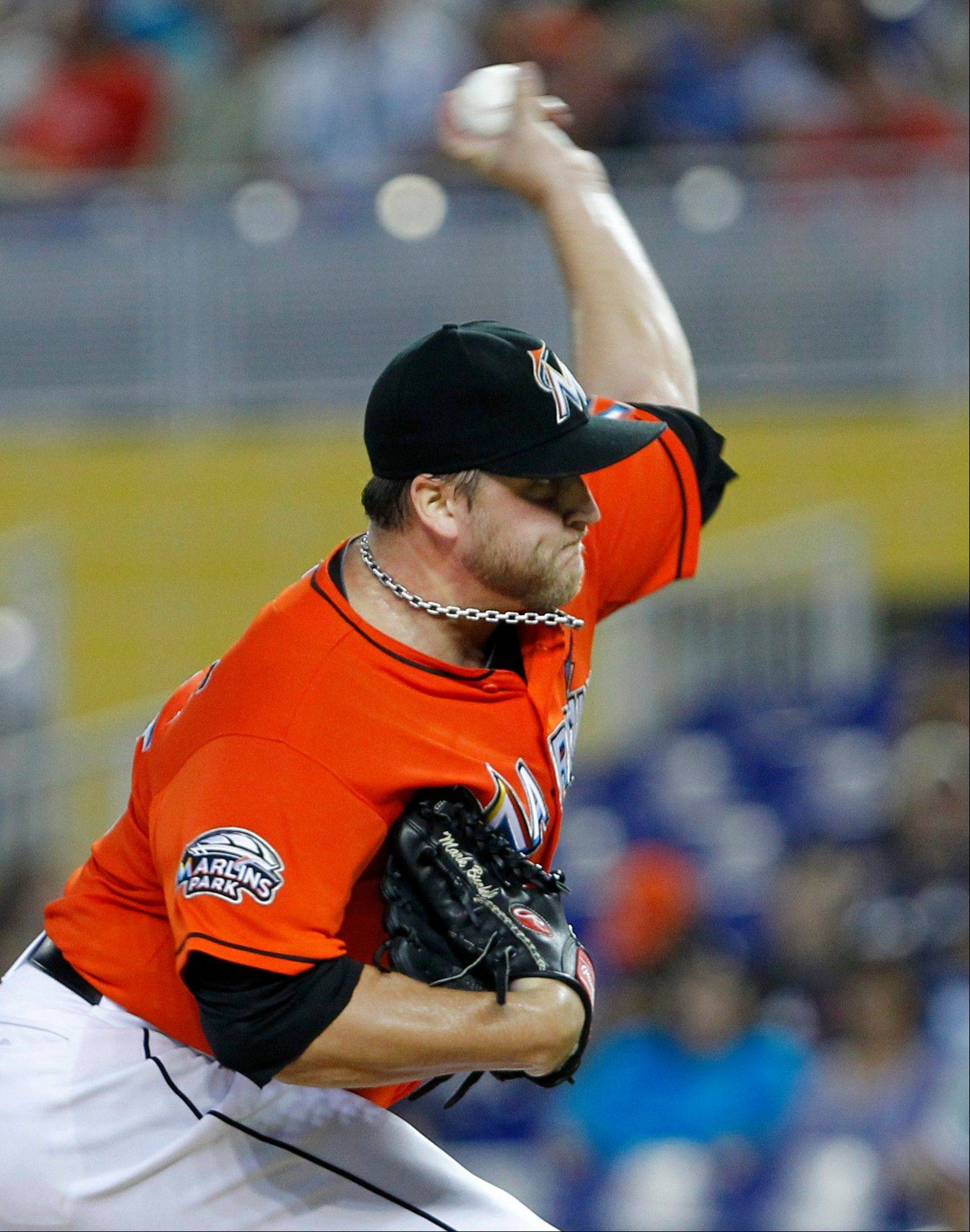 Miami Marlins pitcher Mark Buehrle delivers Wednesday during the third inning against the Philadelphia Phillies in Miami. Buehrle (10-11) achieved the 10-win milestone on his sixth try, extending his streak reaching double digits in victories to 12 consecutive years. The left-hander allowed two runs in seven innings as the Marlins won 9-2.