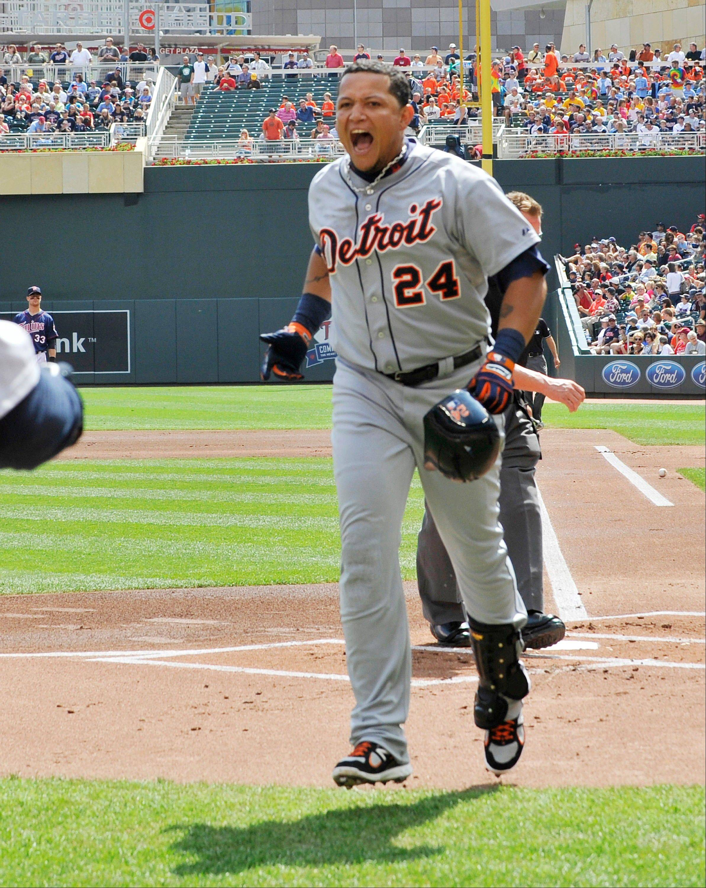 The Detroit Tigers' Miguel Cabrera celebrates his solo home run off Minnesota Twins' Cole DeVries Wednesday during the first inning in Minneapolis. The Tigers won 5-1.