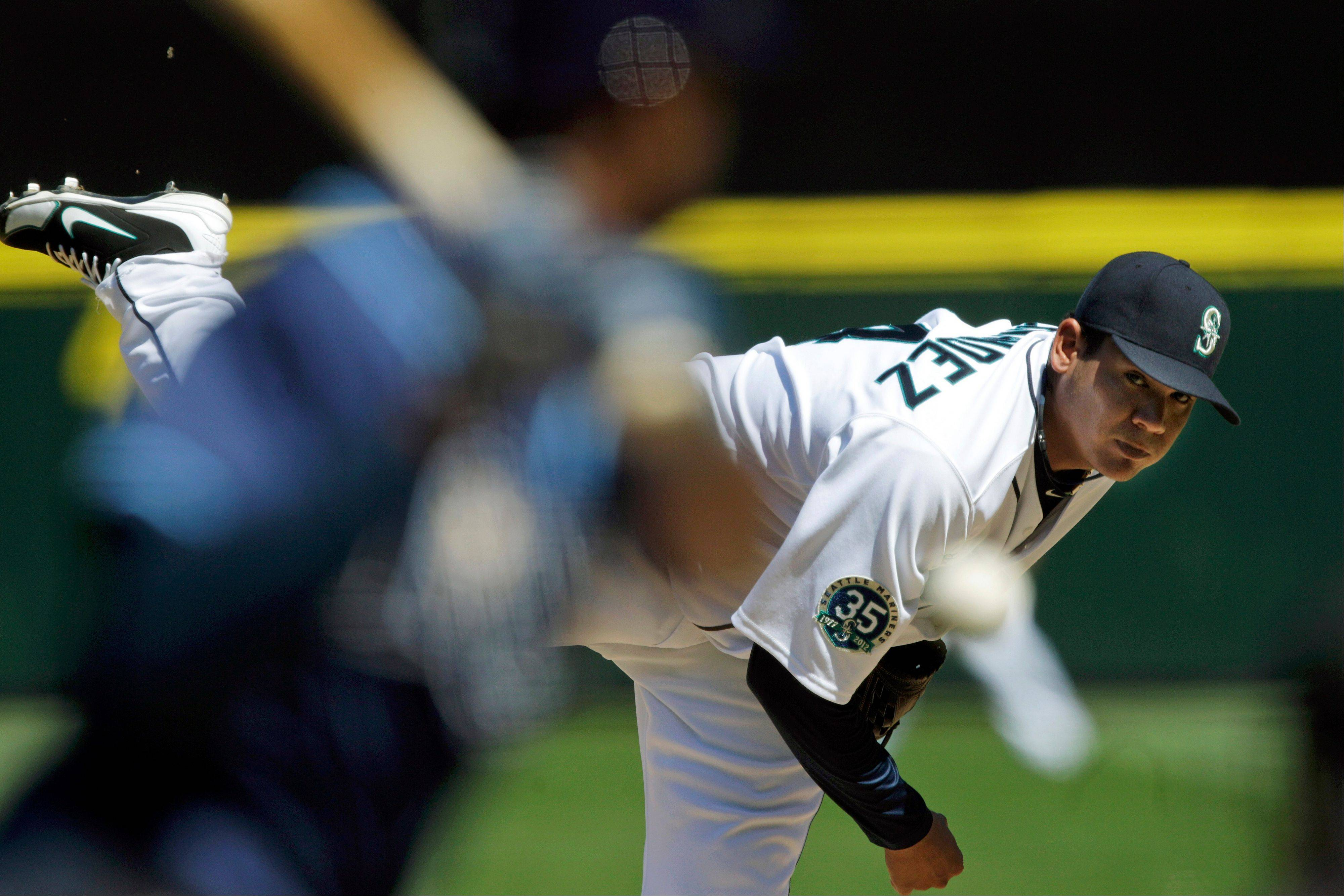 Seattle Mariners starting pitcher Felix Hernandez throws against the Tampa Bay Rays Wednesday during the fourth inning.
