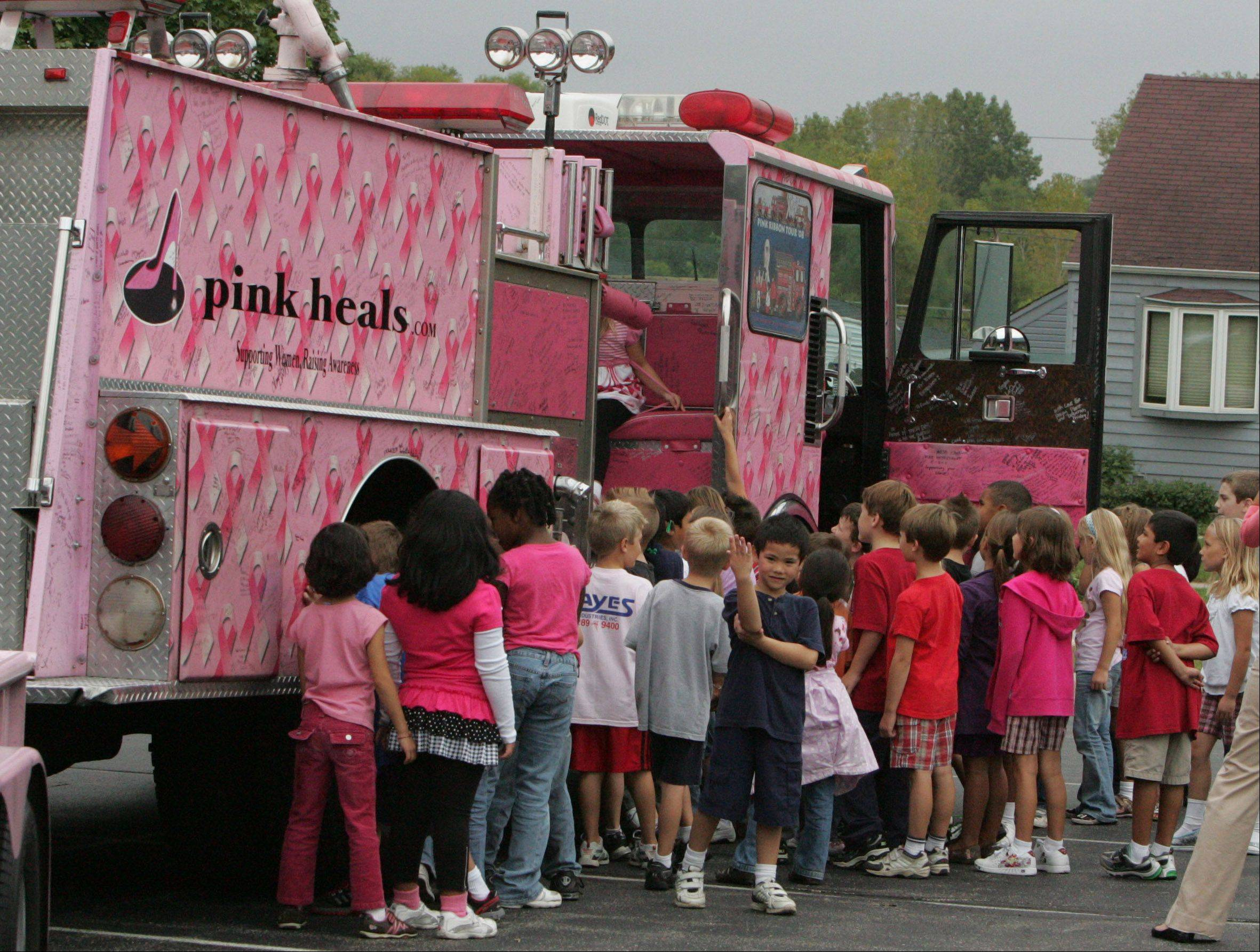 Students crowd around the truck, which tours the nation. This year, most of its local stops will bein DuPage County.