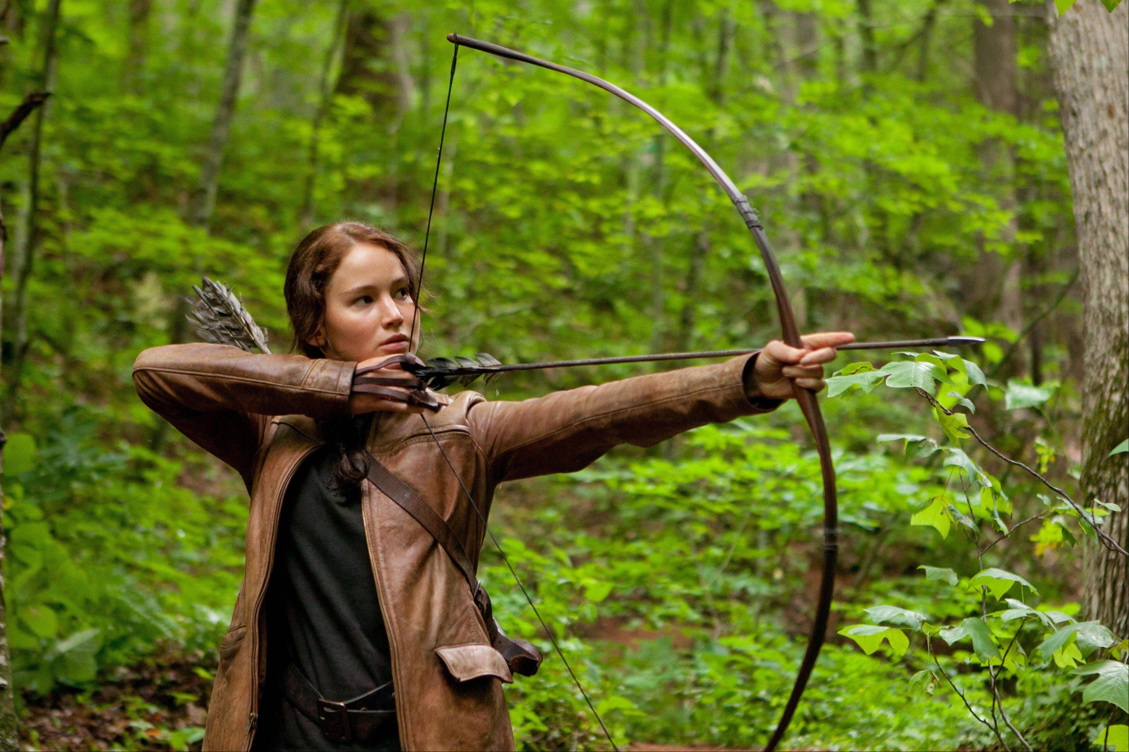 "Jennifer Lawrence plays Katniss Everdeen in ""The Hunger Games,"" set for DVD release this week. Lawrence is among several teens fighting to the death in a televised competition in post-apocalyptic North America."