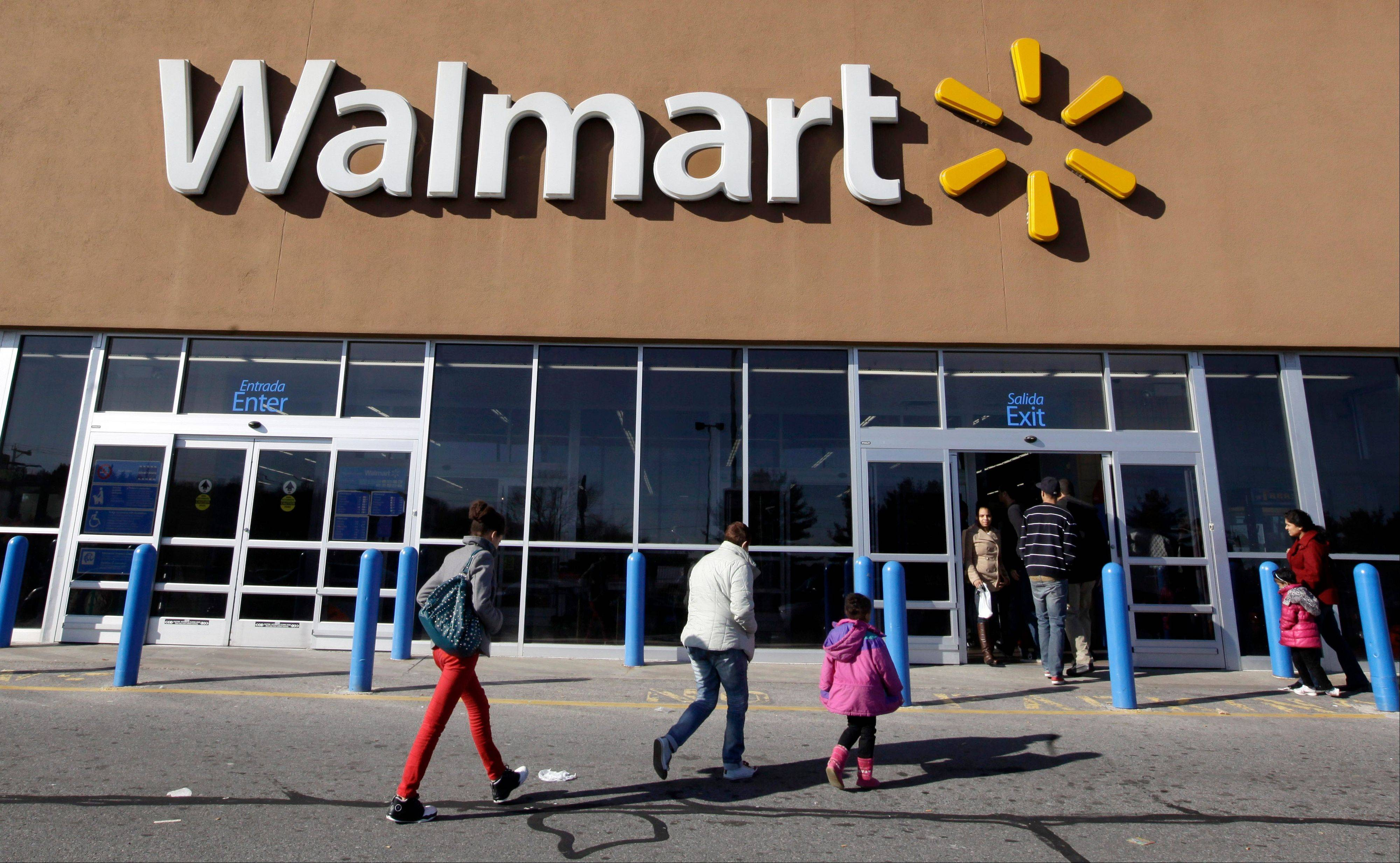 Associated Press/Feb. 20, 2012 Customers walk into and out of a Wal-Mart store in Methuen, Mass. Wal-Mart Stores Inc. reported a 5.7 percent increase in second-quarter net income and raised its outlook for the full year.