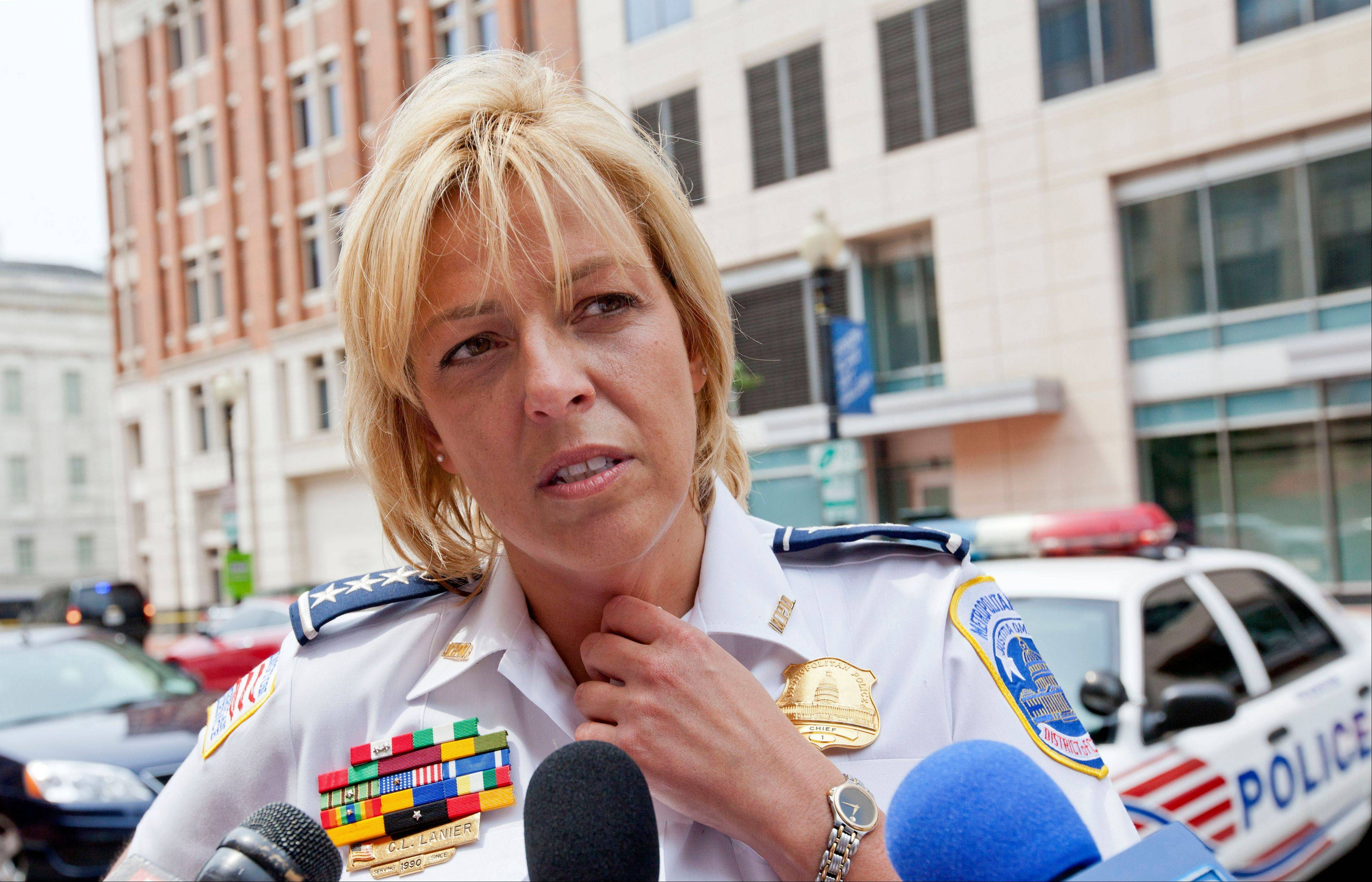 Washington Police Chief Cathy Lanier meets with reporters near the Family Research Council in Washington, Wednesday, Aug. 15, 2012, after a security guard for the lobbying group was shot in the arm.