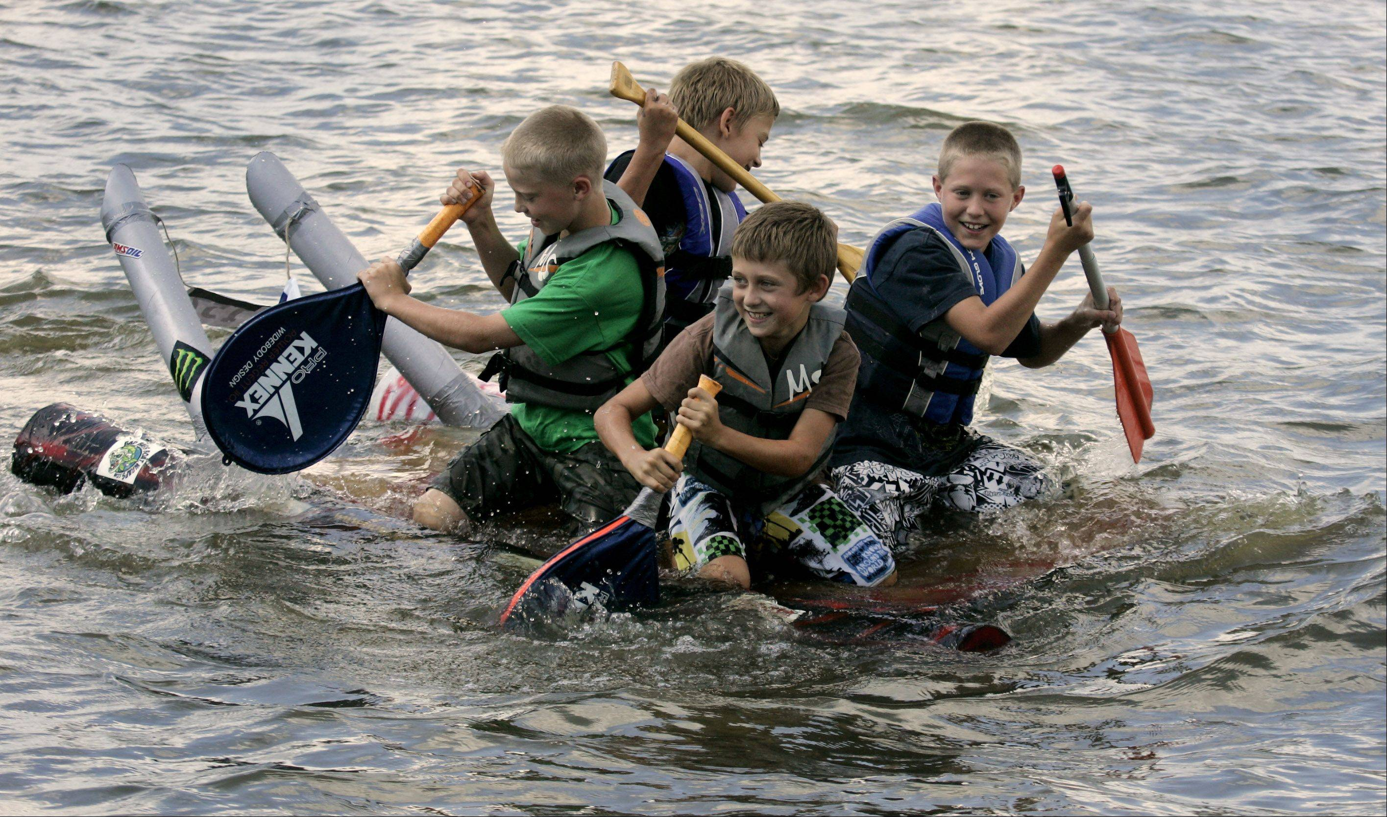 Tennis rackets were used as oars during last year's Fox Lake Cardboard Cup Regatta at Lakefront Park.