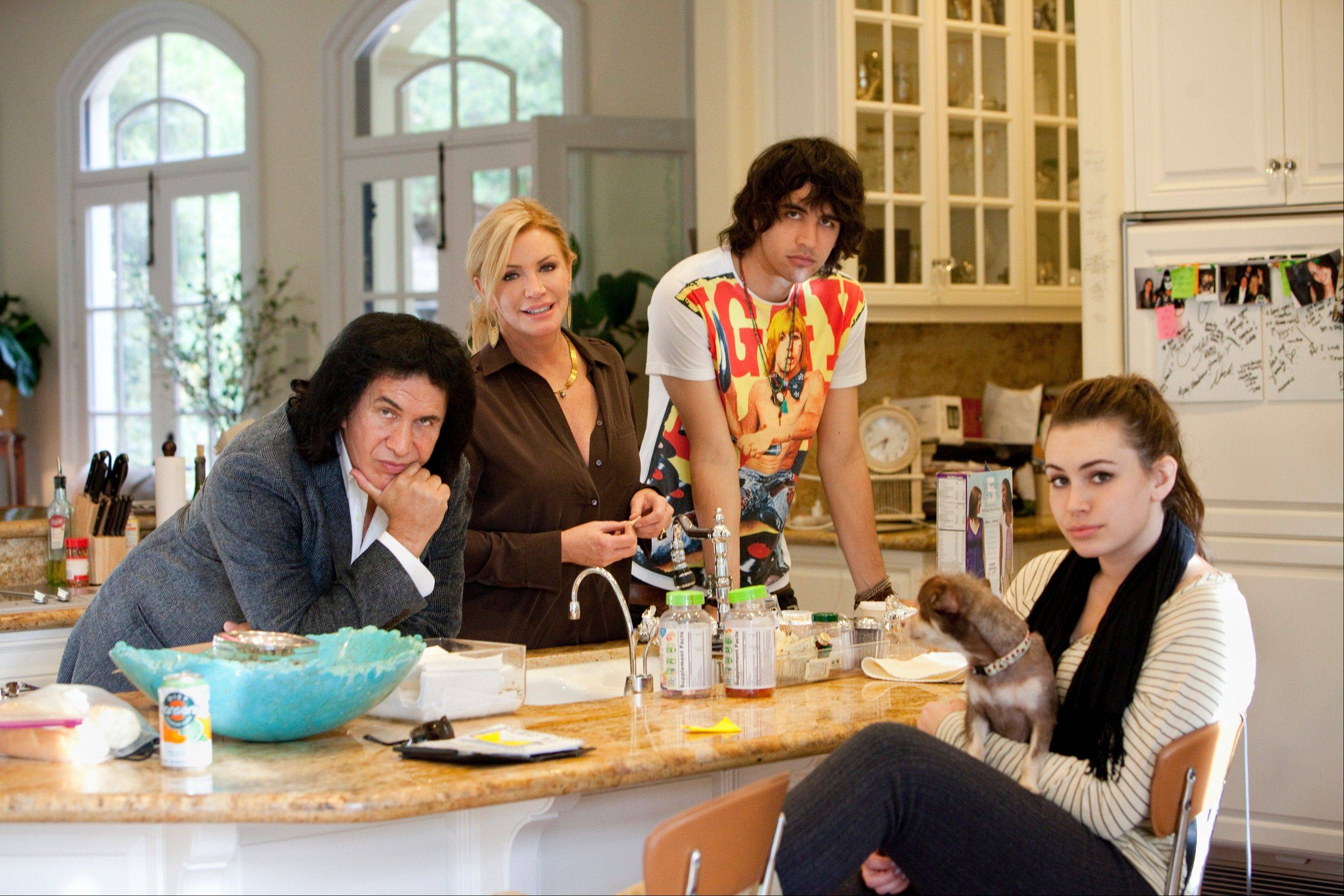 "Gene Simmons, left, Shannon Tweed, Nick Simmons and Sophie Simmons in their A&E reality series, ""Gene Simmons Family Jewels,"" which will be ending after seven seasons."