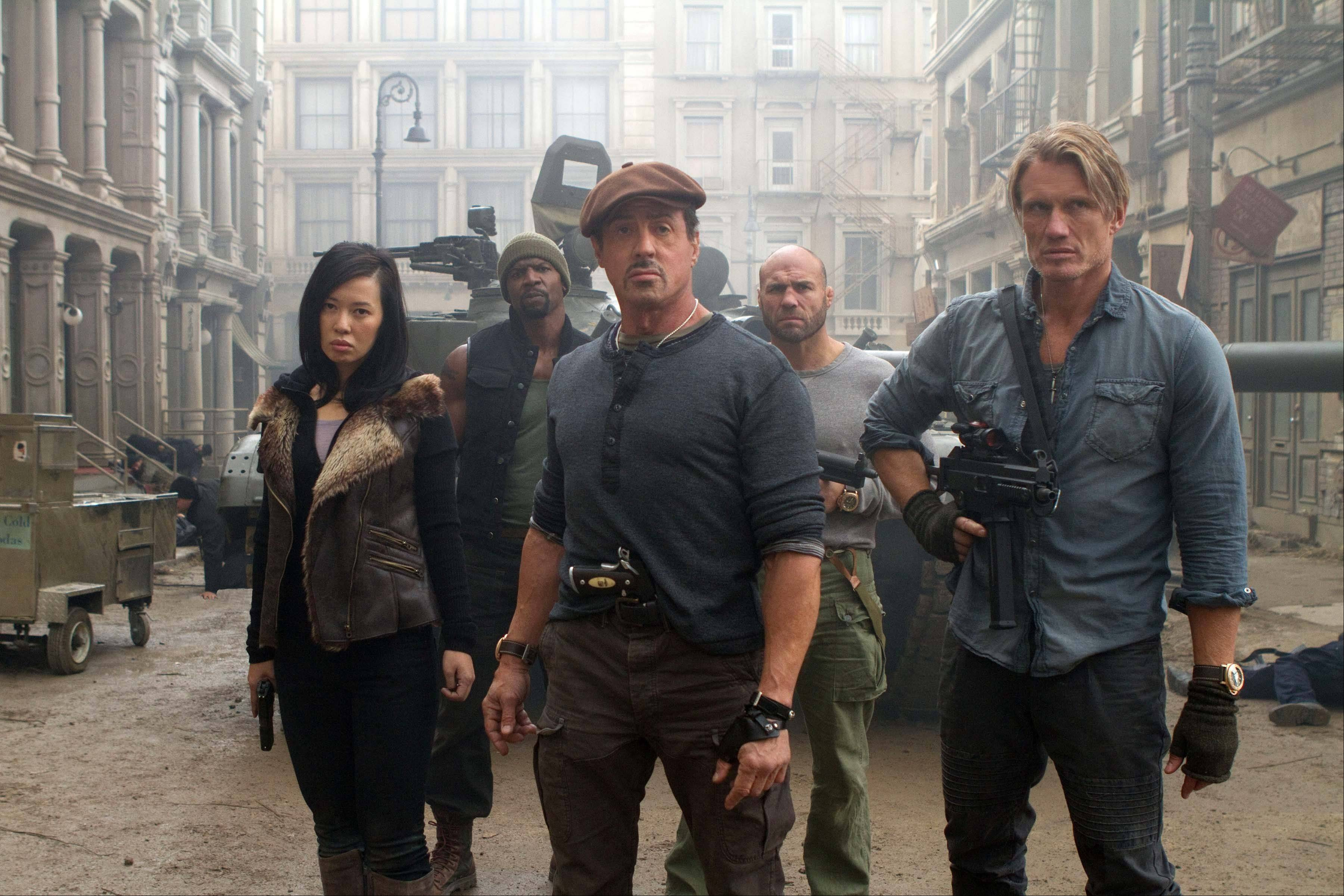 Ready for action are Yu Nan, left, Terry Crews, Sylvester Stallone, Randy Couture and Dolph Lundgren in The Expendables 2.""