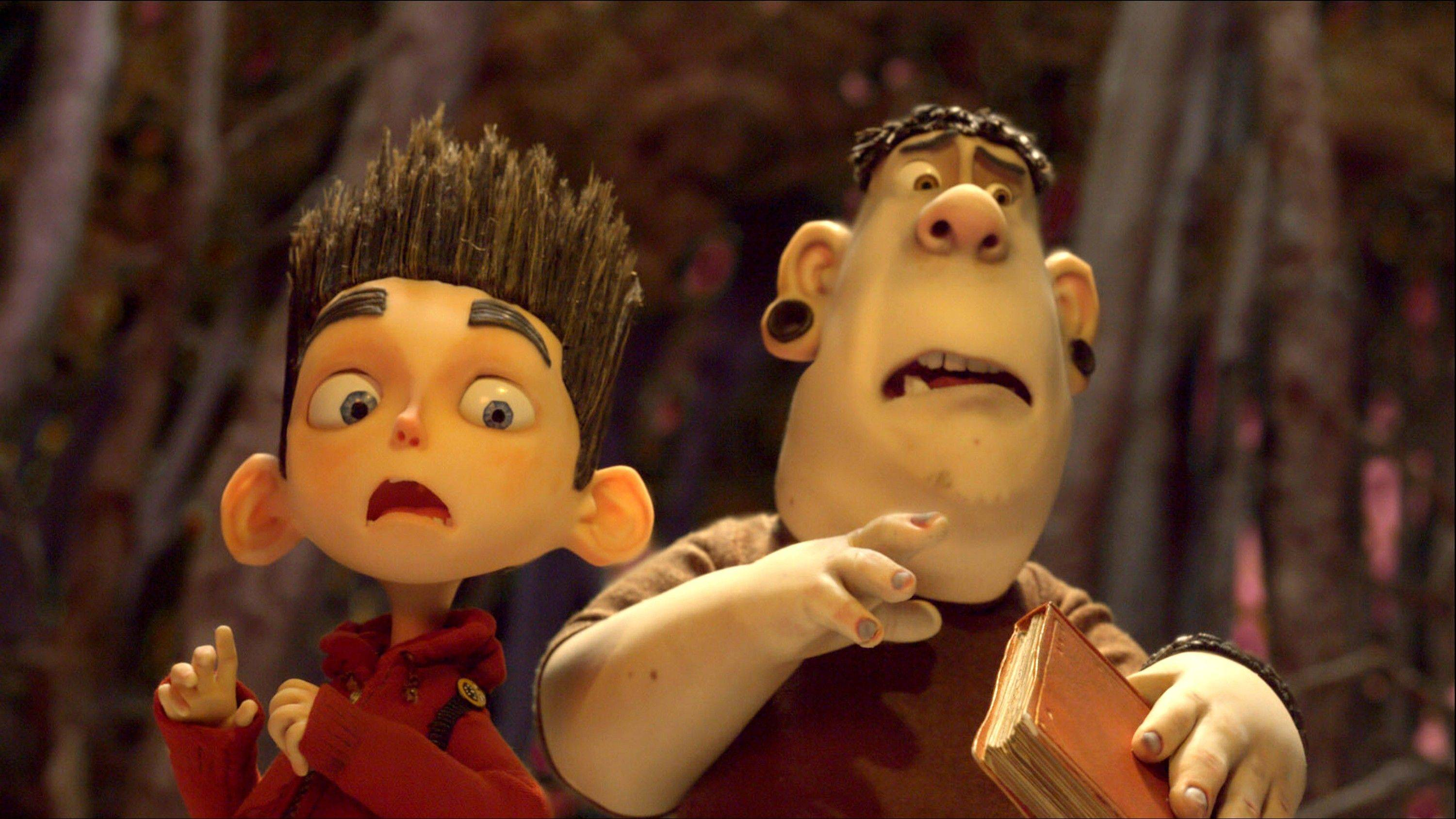 "Alvin (voiced by Christopher Mintz-Plasse), right, takes a break from bullying Norman (Kodi Smit-McPhee) to escape from zombies in ""ParaNorman."""