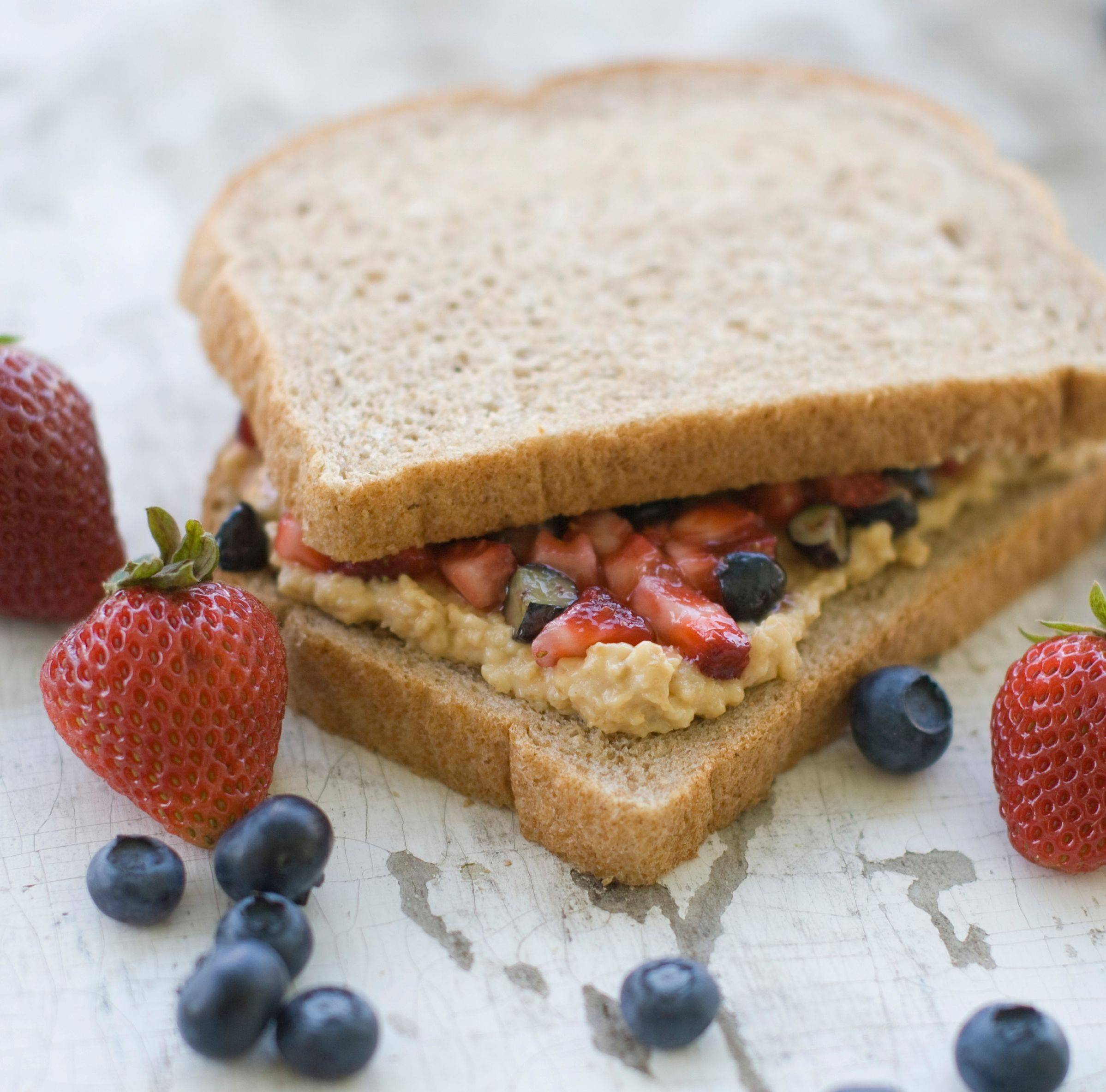 Fresh berries and natural fruit spread make for a healthier PB&J sandwich.