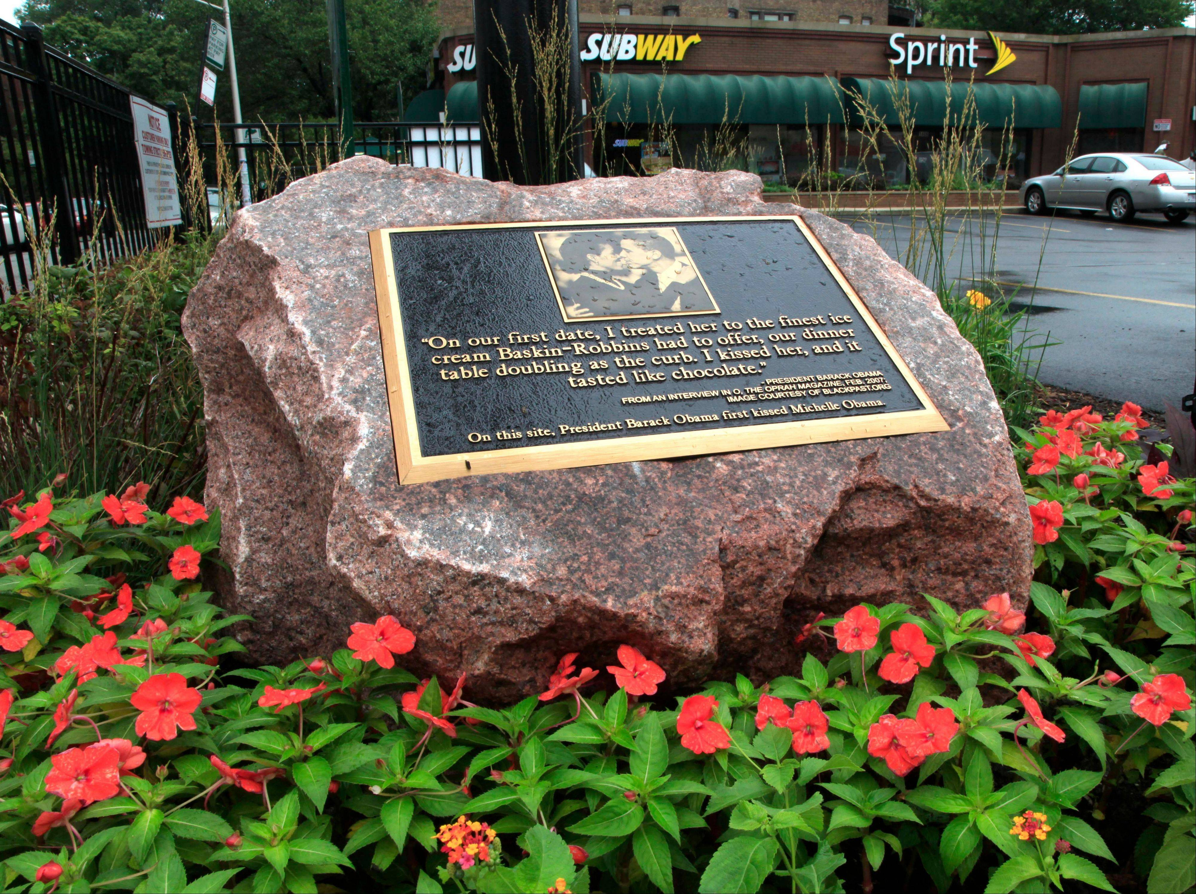 The owners of a shopping center in Chicago's Hyde Park neighborhood installed the granite marker this week. The Obamas will celebrate their 20th wedding anniversary in October.