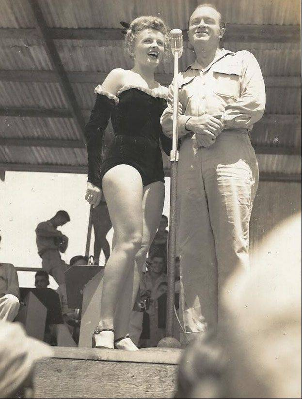 Frank Kania was photographer for several USO shows during World War II. Here, in August 1944, Patty Thomas and Bob Hope entertain the troops.