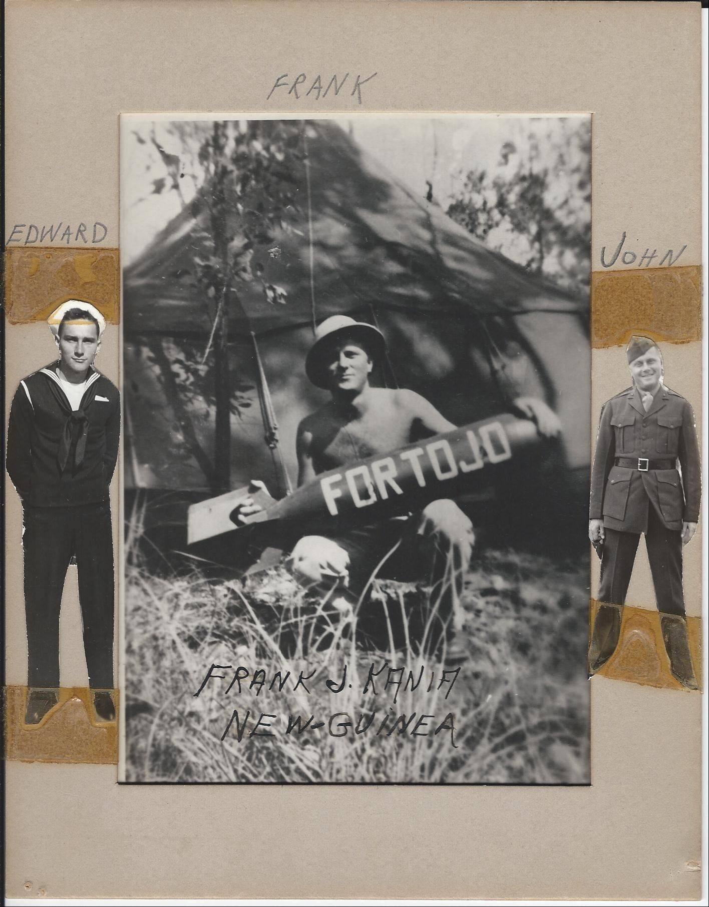 Frank Kania holds a bomb referring to the Japanese general in the middle photo, flanked by photos of his brothers Edward and Johnny during their service in World War II..