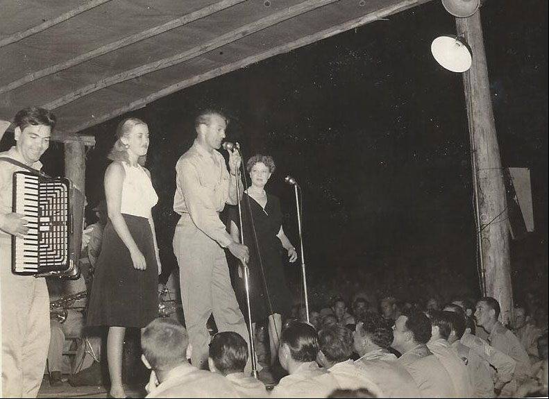 Frank Kania was photographer for several USO shows during World War II. Here, in November 1943, Phyllis Brooks, Gary Cooper and Una Merkle entertain the troops