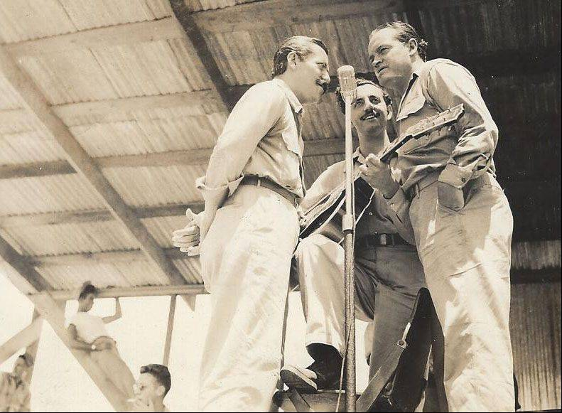 Frank Kania was photographer for several USO shows during World War II. Here, in August 1944, Jerry Colonna, Bob Hope and guitarist Tony Romano entertain the troops.