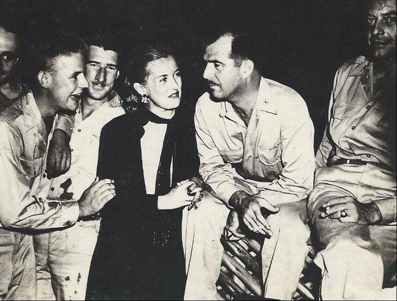 Frank Kania was photographer for several USO shows during World War II. Here, in November 1943, Phyllis Brooks and Gary Cooper entertain the troops.