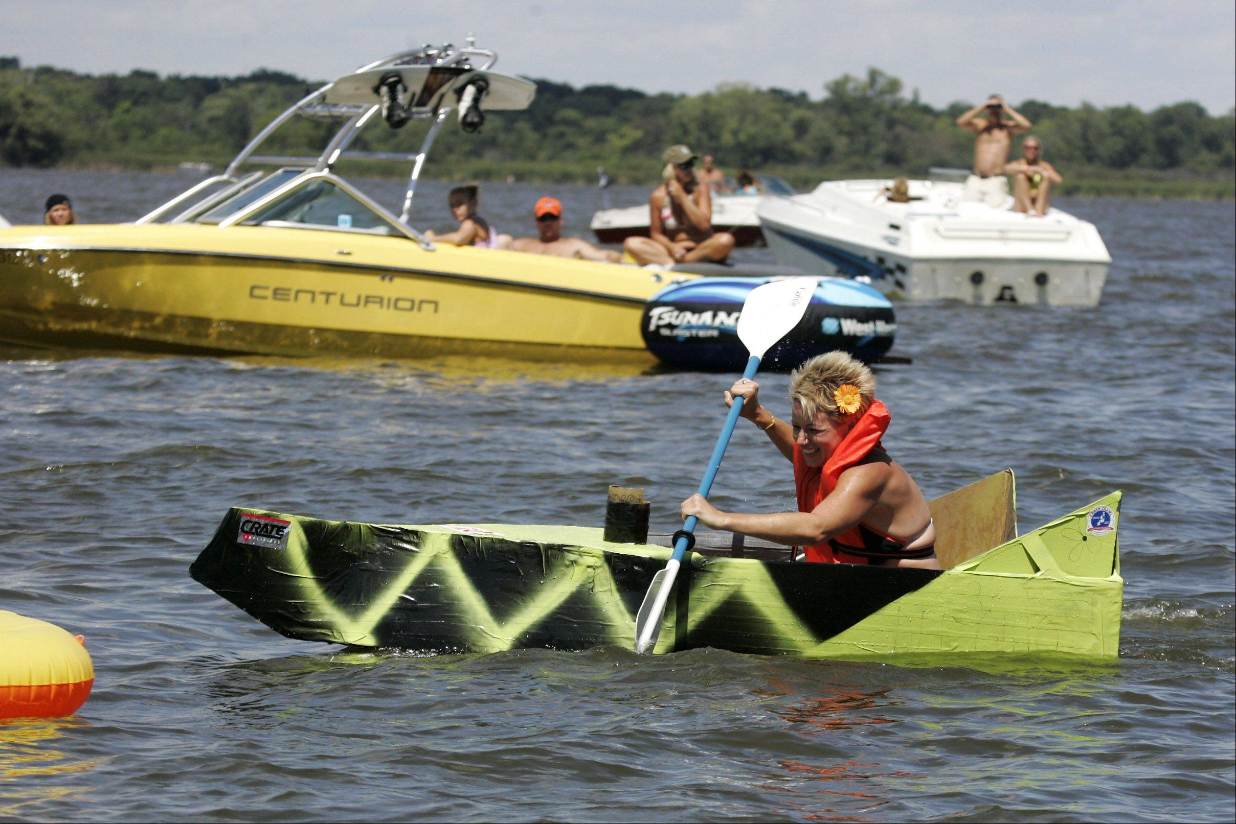 Kim Sufin of Ingleside paddles through the course during last year's Fox Lake Cardboard Cup Regatta.