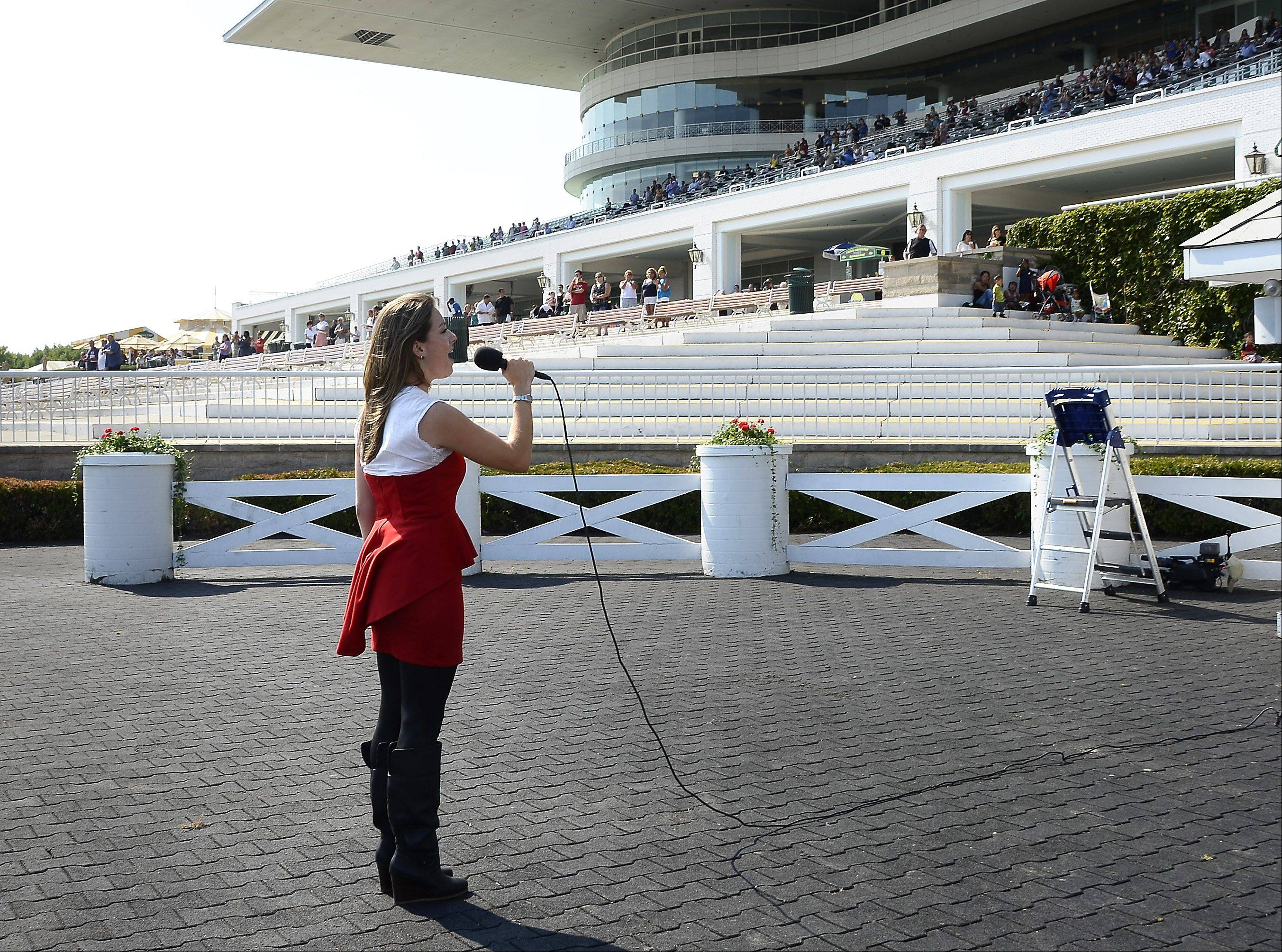 Prospect High School graduate Jean Laurenz is now in her fifth summer as Arlington Park's bugler. The 25-year-old also sings the national anthem there and is entering her final year of a master's in music program at Yale University.