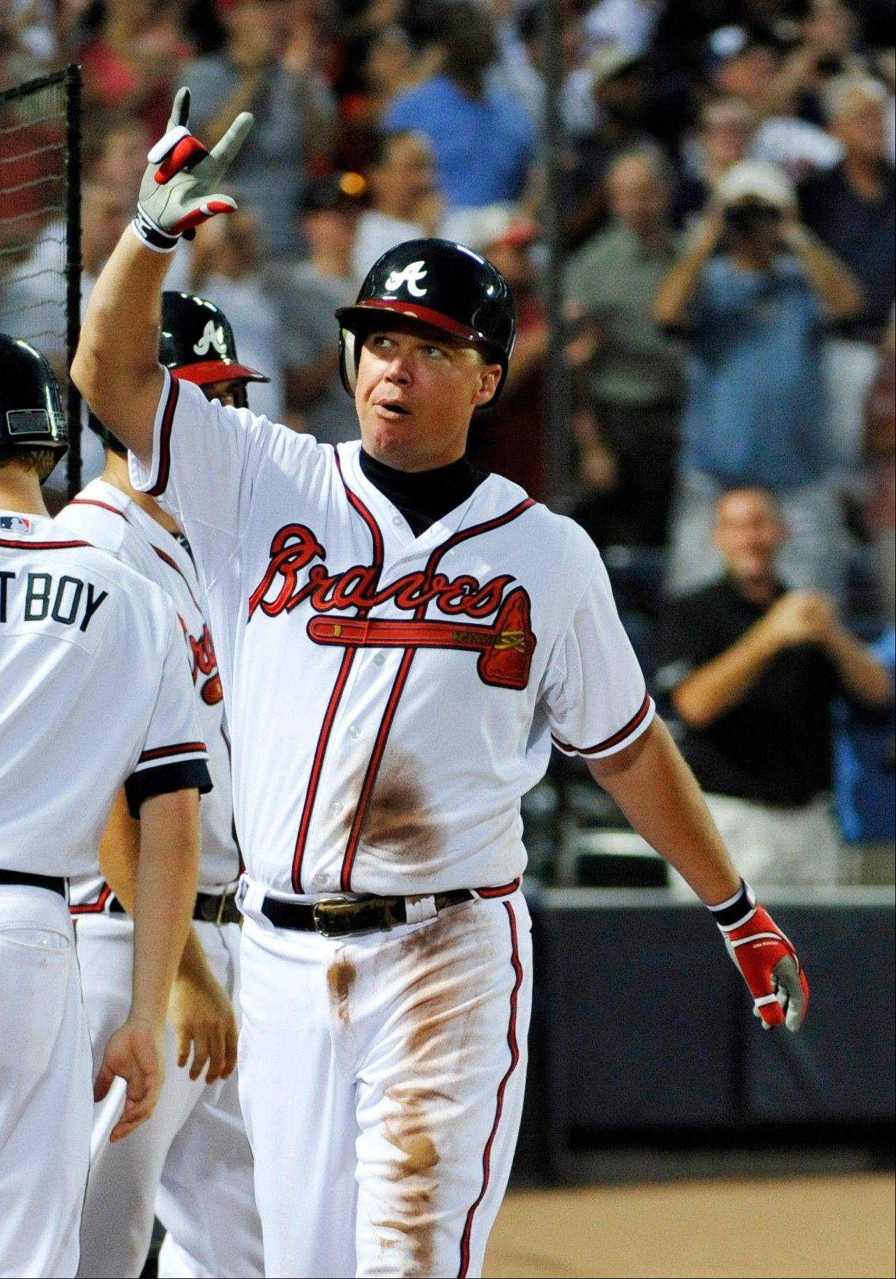 Atlanta's Chipper Jones acknowledges the crowd after hitting a home run Thursday for his 2,700th career hit.