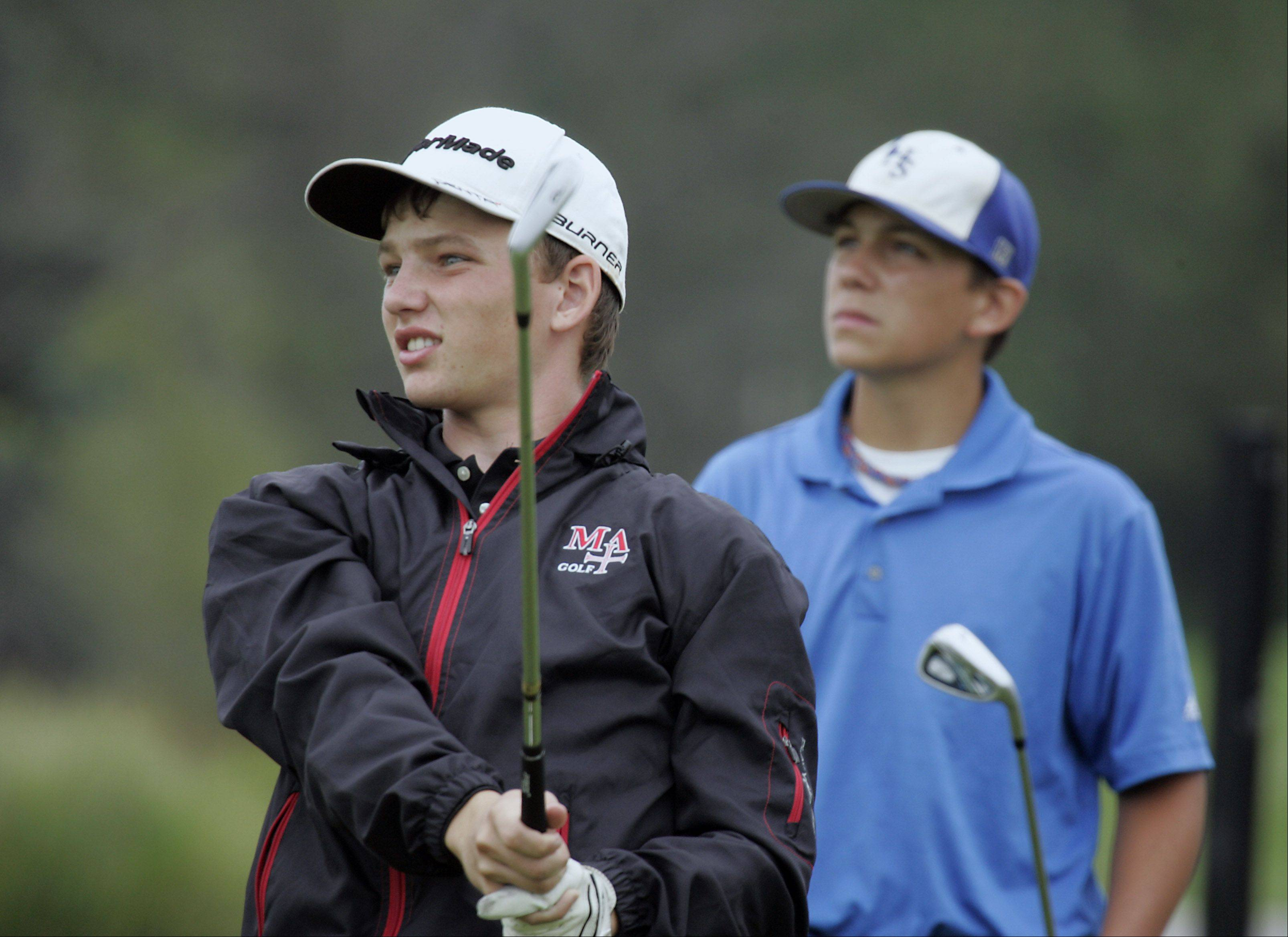 Marmion's Joe Fritz, watches his tee shot on the 8th hole as Larkin's Dan Lenz, follows the ball during the Geneva boys golf invite Thursday at Mill Creek Golf Club in Geneva.