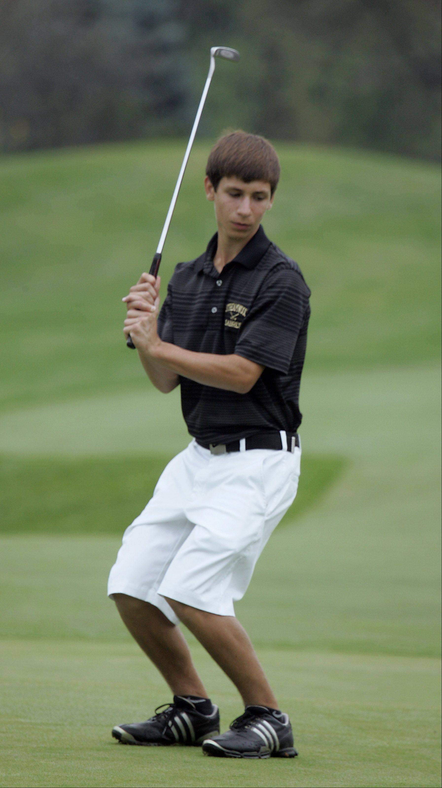 Kaneland's Luke Kreiter, reacts to his putt on the third green during the Geneva boys golf invite Thursday at Mill Creek Golf Club in Geneva.
