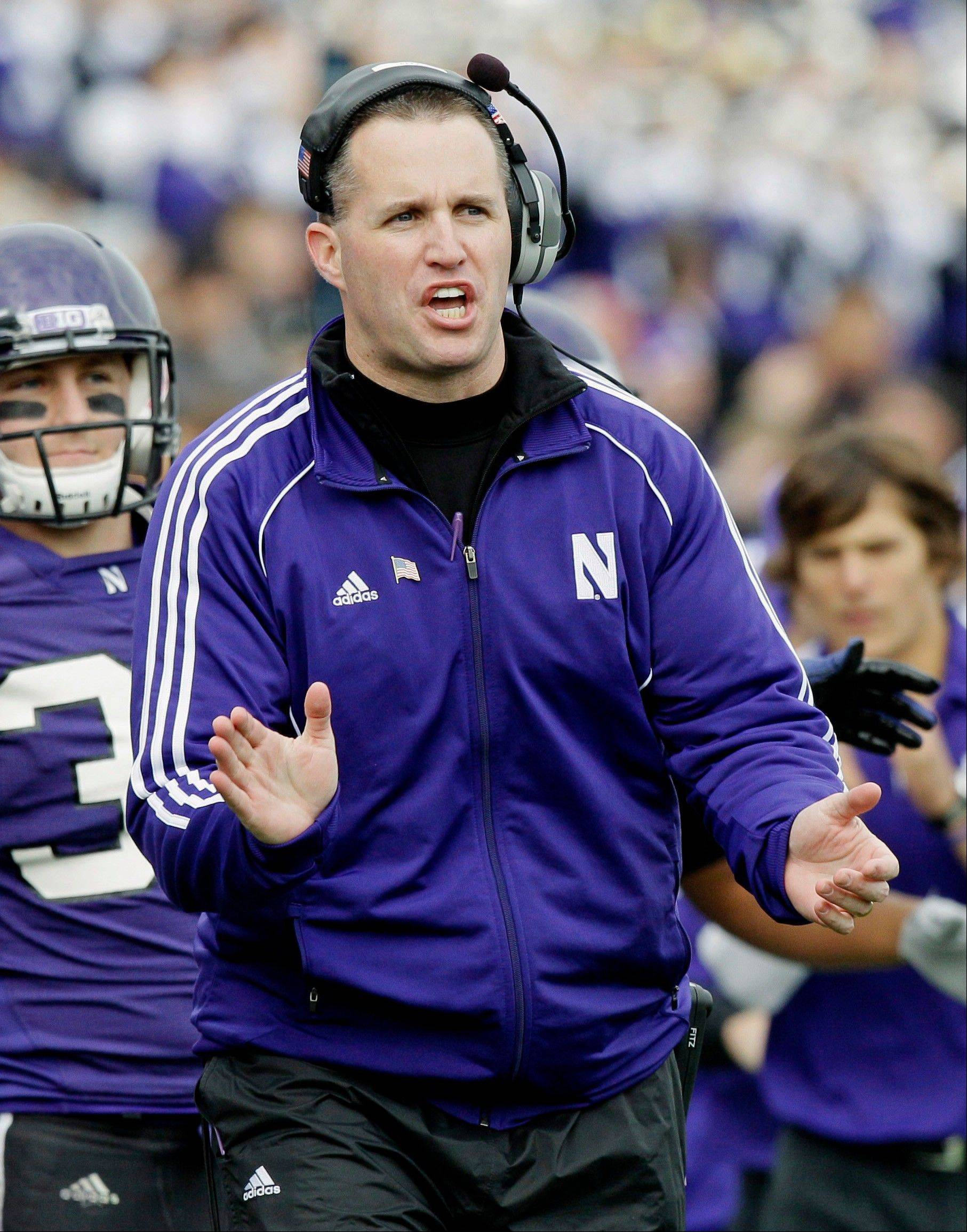 Northwestern head coach Pat Fitzgerald shouts instructions to his players during a game against Minnesota in Evanston. Northwestern's season opener is Sept. 1, 2012 against Syracuse.