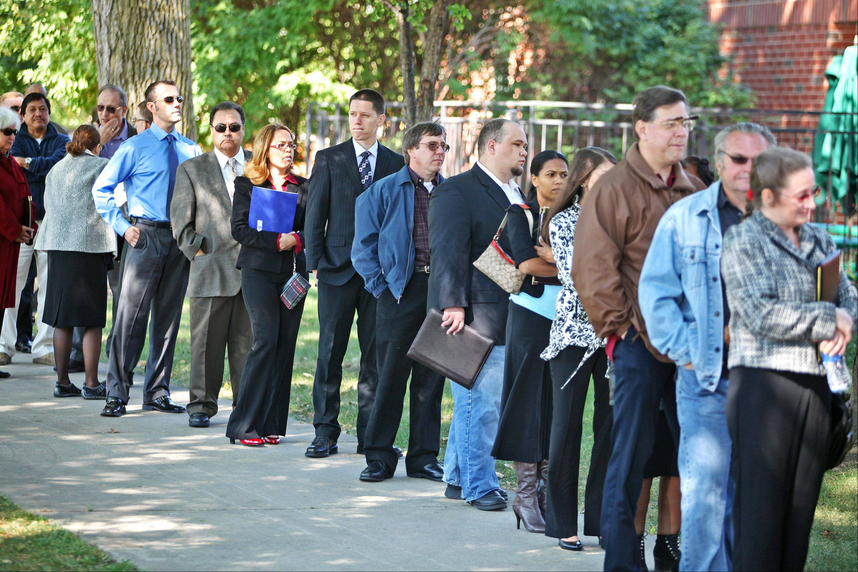 The number of Americans applying for unemployment benefits edged up slightly last week but remained at a level consistent with modest gains in hiring.