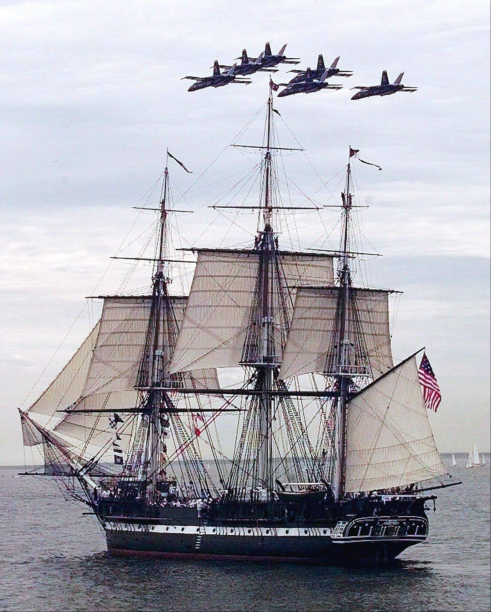 The Blue Angels fly in formation over the USS Constitution as she free sails off the coast of Marblehead, Mass., in celebration of her 200th birthday in 1997.