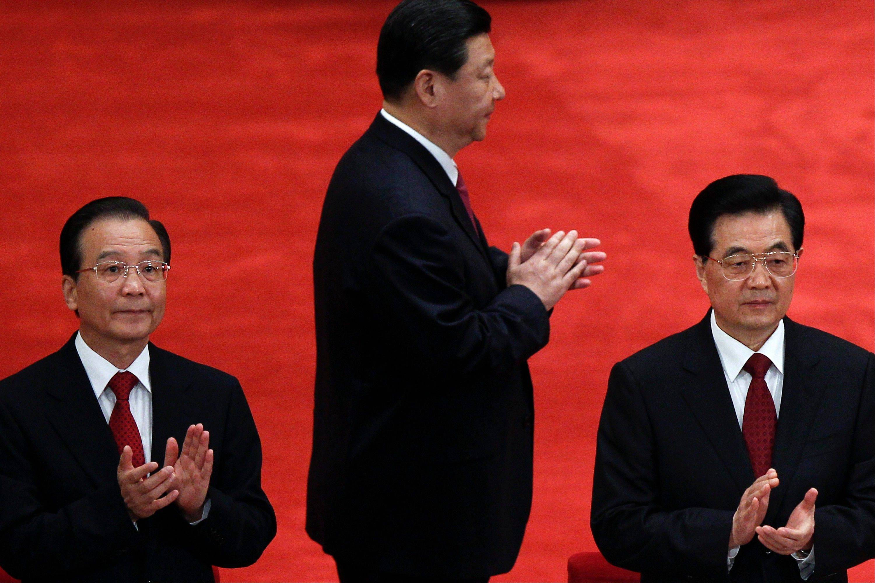 Chinese President Hu Jintao, right, Premier Wen Jiabao, left, and Vice President Xi Jinping, center, clap as they arrive for a conference to celebrate the 90th anniversary of the founding of the Chinese Communist Youth League at the Great Hall of the People in Beijing. The world's two biggest economies are entering the final stages of political campaigns to pick their national leaders. While American candidates wage loud, rah-rah campaigns with a clear timetable as they head toward the Nov. 6 presidential election, China hasn't even announced the date for this fall's Communist Party congress that will appoint the next top leader to replace outgoing Hu Jintao — a post widely expected to go to Vice President Xi Jinping.