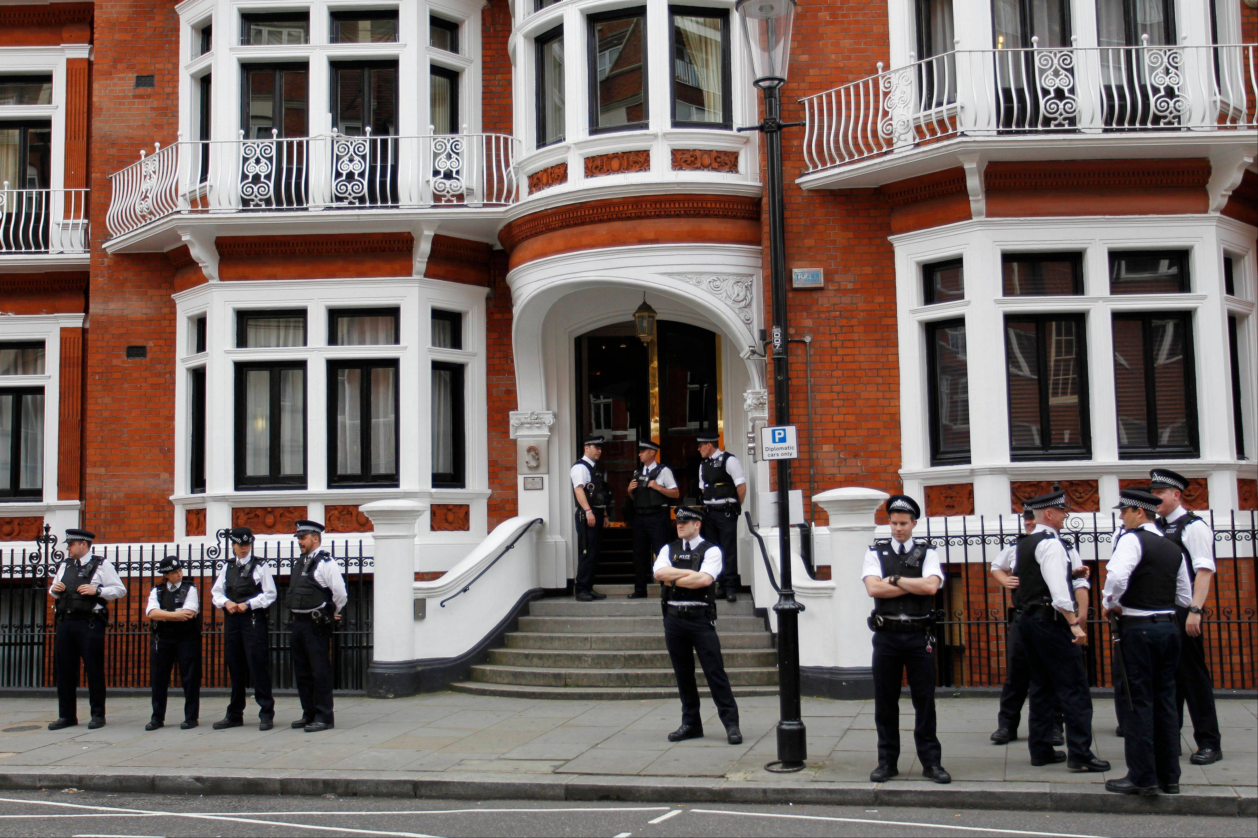 British police officers stand guard outside the Ecuadorean Embassy in central London, Thursday, Aug. 16, 2012 after Ecuadorean Foreign Minister Ricardo Patino announced that he had granted political asylum to WikiLeaks founder Julian Assange. He's won asylum in Ecuador, but Julian Assange is no closer to getting there.