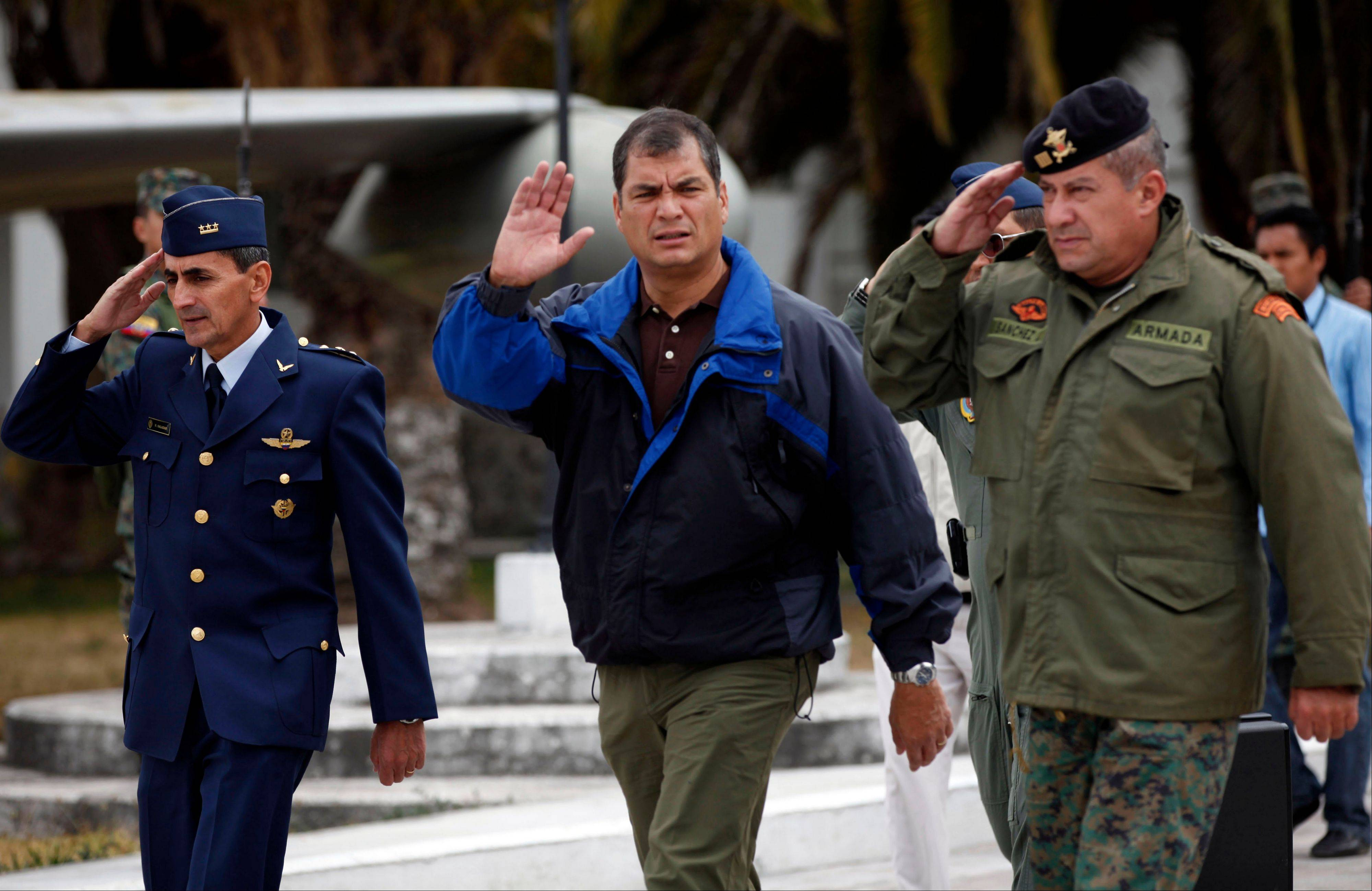 Ecuador's President Rafael Correa, center, waves before flying by plane to the Ecuadorean city of Loja at the airport in Quito, Ecuador, Thursday, Aug. 16, 2012. Ecuador would grant asylum to WikiLeaks' founder Julian Assange two months after he took refuge in its London embassy to avoid extradition to Sweden to face questioning for alleged sexual misconduct.