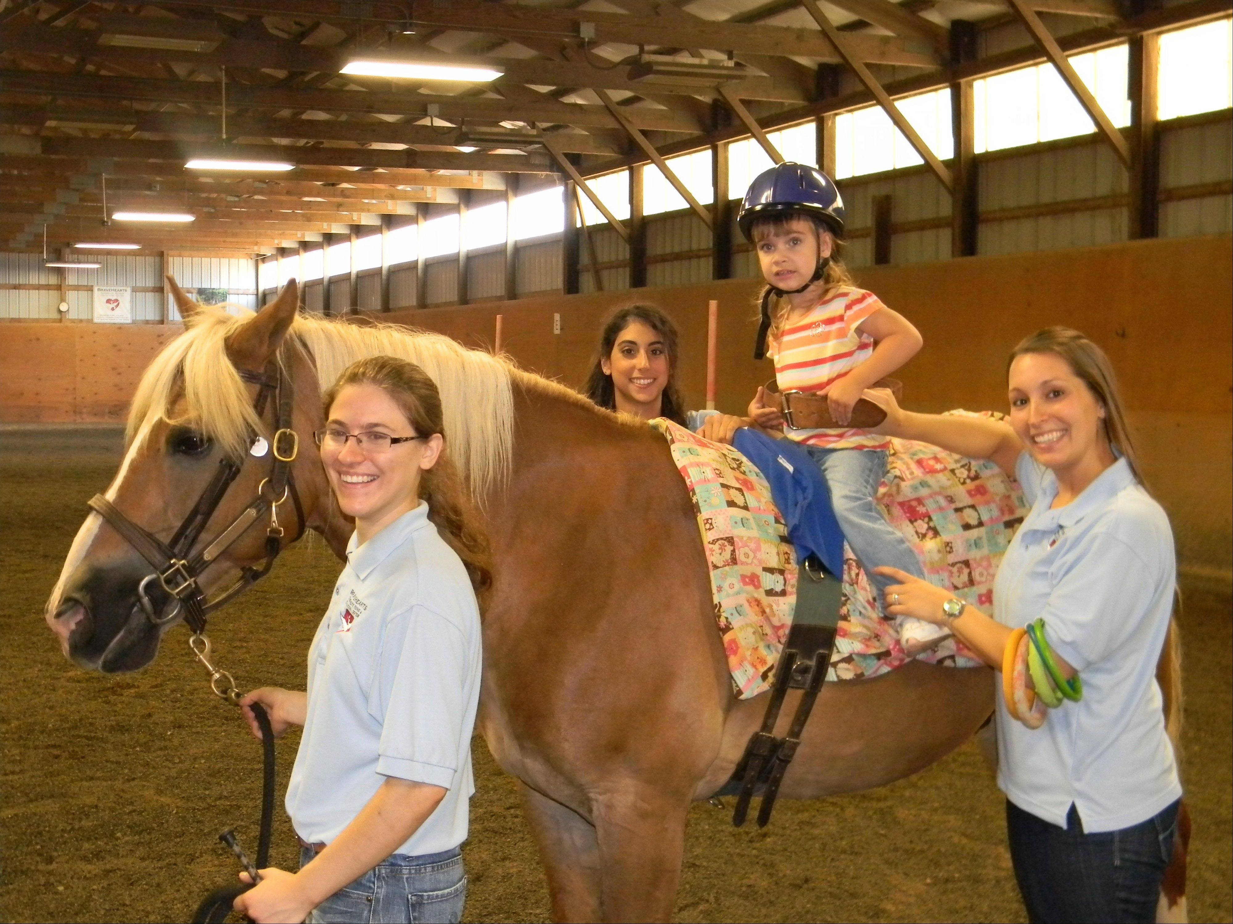 Abbey Ross, 4, is among 200 people building strength and confidence through horseback riding programs offered by BraveHearts Therapeutic Riding and Education Center. The center's fundraiser Saturday, Aug. 18, features an appearance by actress and animal lover Betty White.