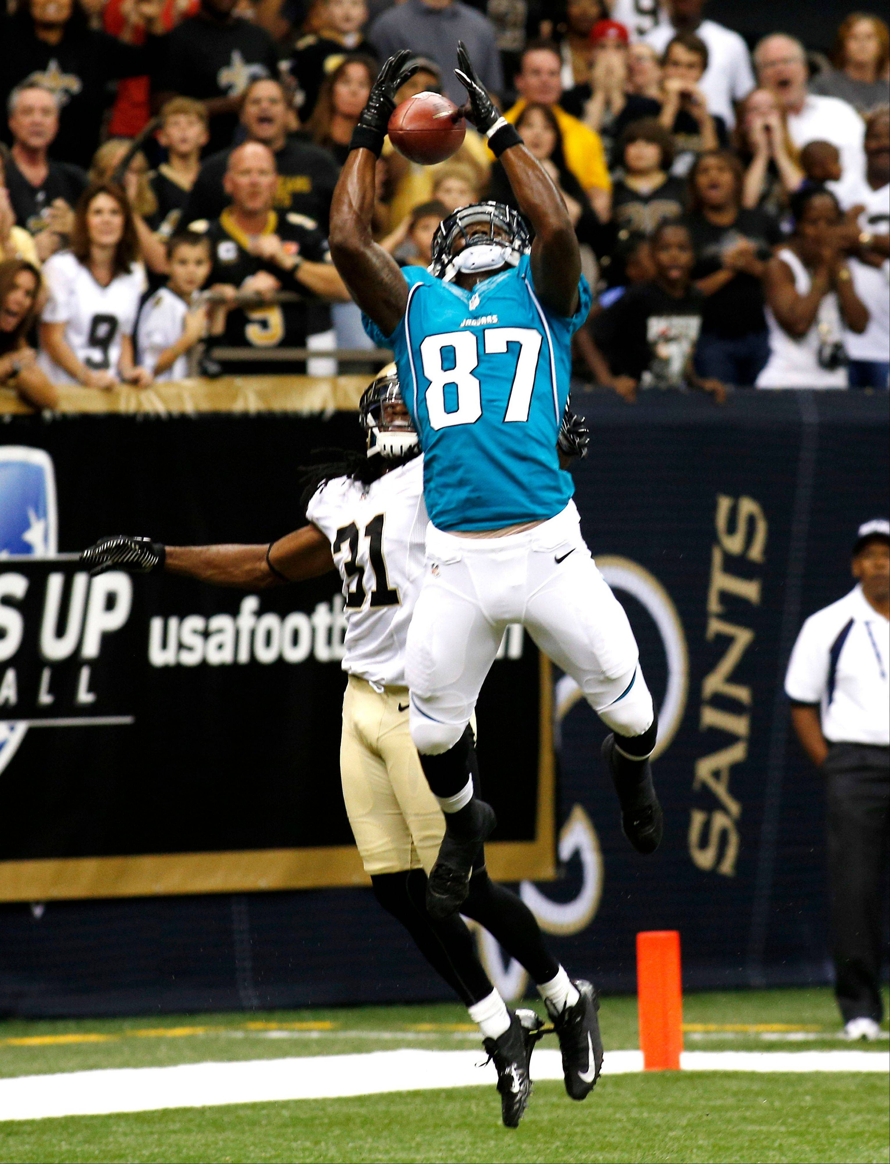 Jaguars wide receiver Kevin Elliott pulls in the game-winning touchdown pass over Saints defensive back Cord Parks on Friday night in preseason action in New Orleans.