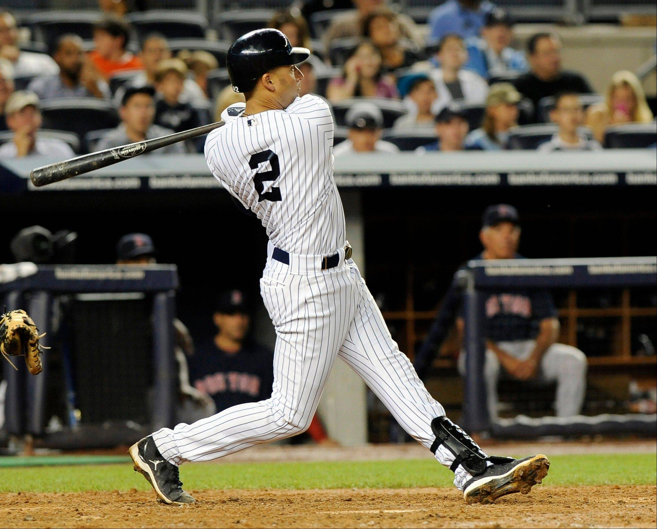 The Yankees' Derek Jeter hits a solo home run off Boston's Franklin Morales in the fifth inning Friday in New York.