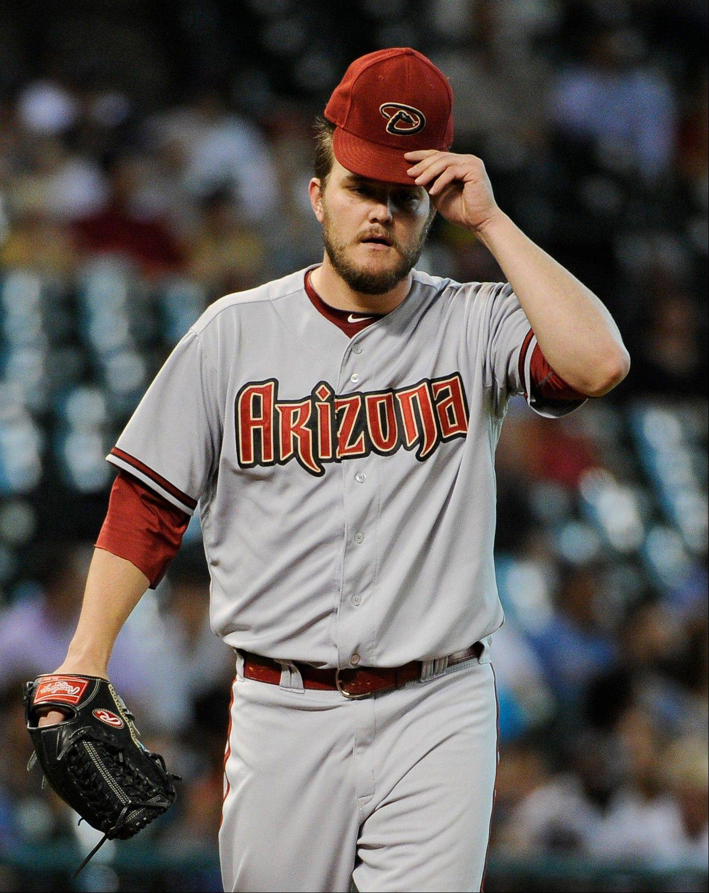 Arizona Diamondbacks pitcher Wade Miley struck out five and walked none Friday in Houston for his first win since July 31.