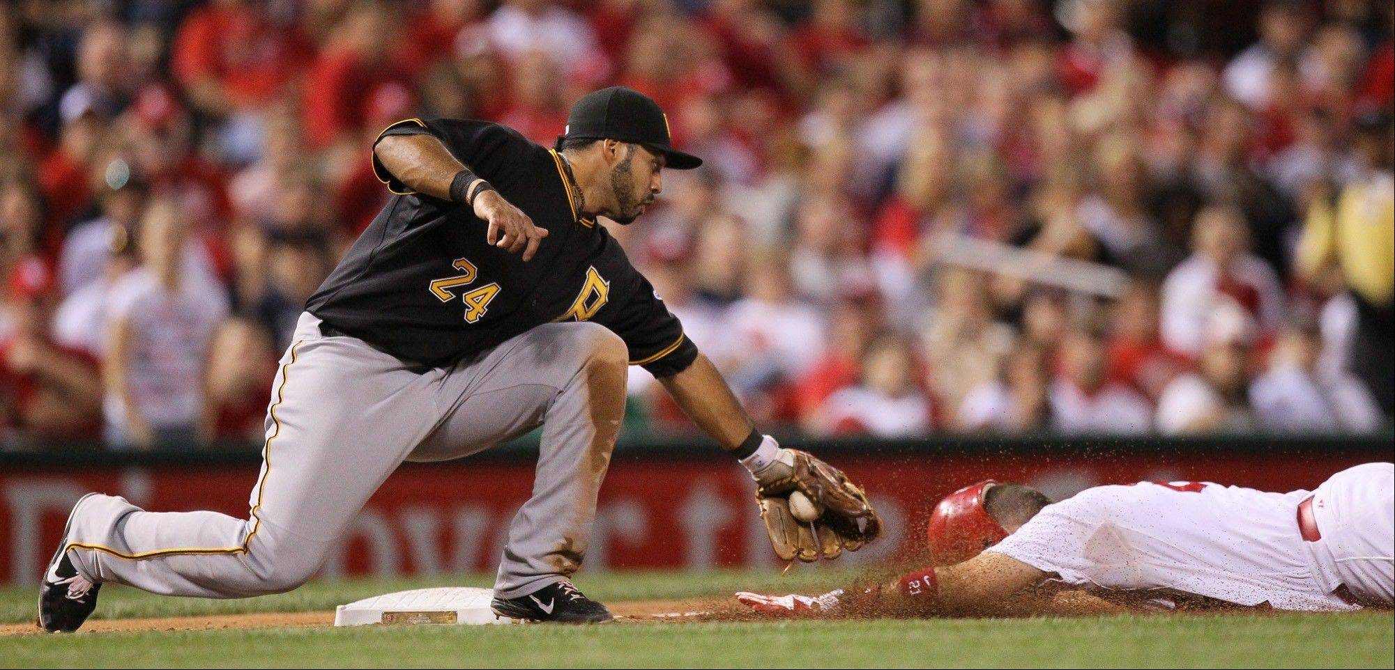 Pittsburgh Pirates third baseman Pedro Alvarez tags out the Cardinals' Allen Craig, who was trying to steal third base in the fourth inning Friday in St. Louis.