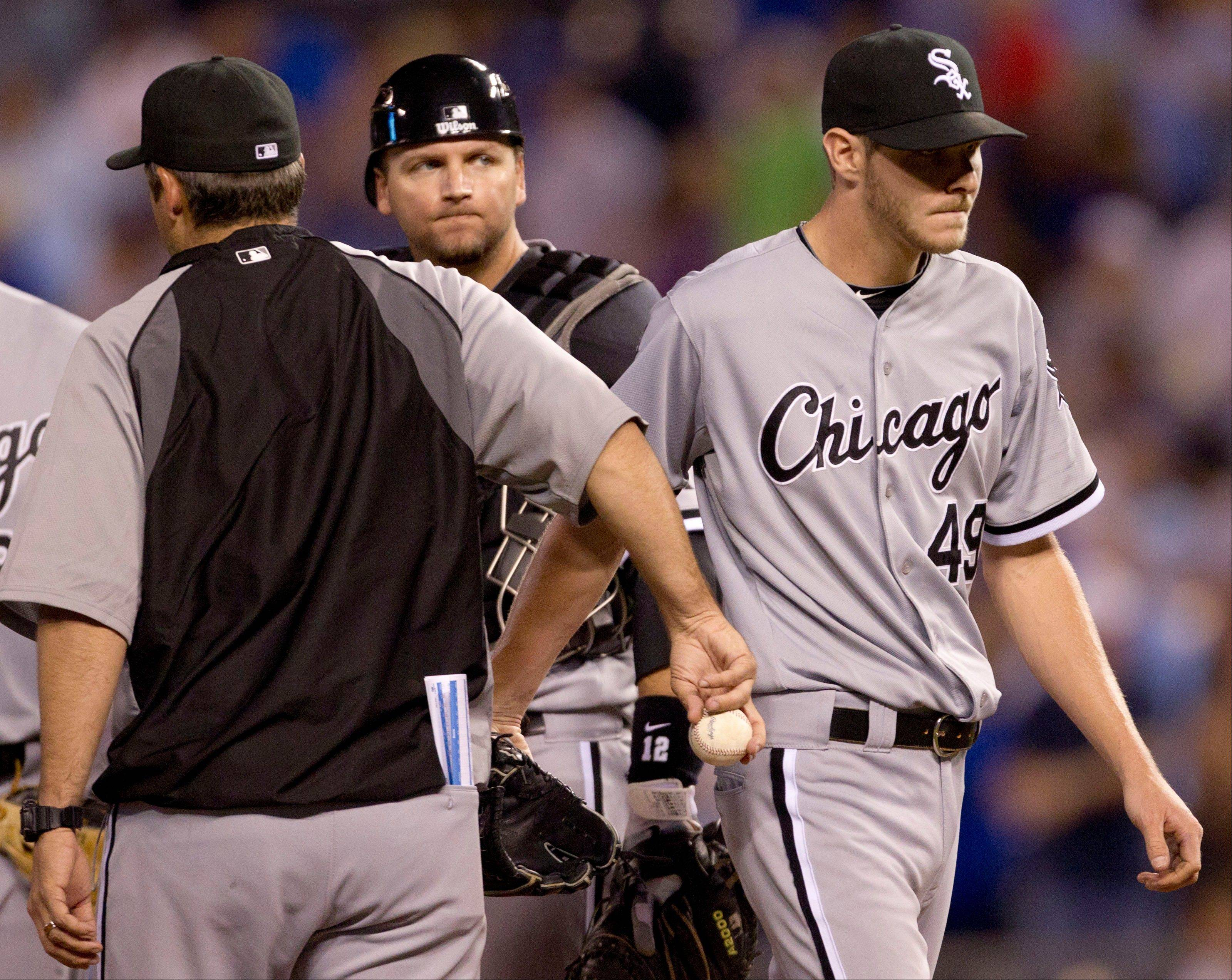 White Sox starting pitcher Chris Sale (49) is taken from the game by manager Robin Ventura during the seventh inning Friday against the Kansas City Royals at Kauffman Stadium in Kansas City,
