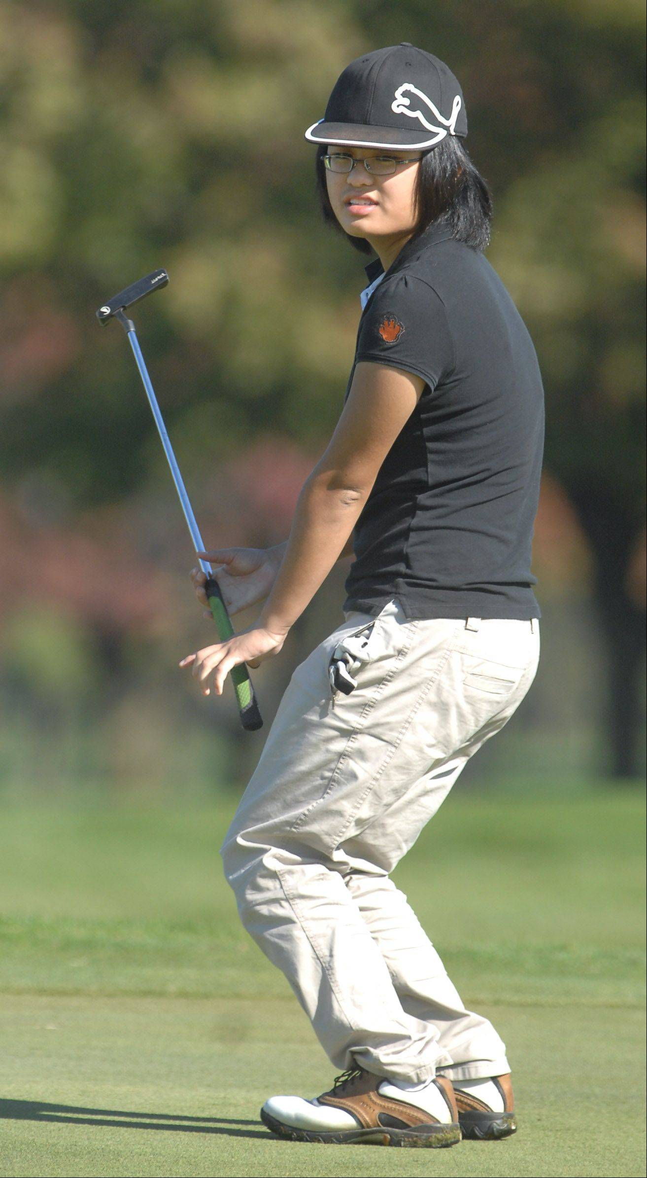 Libertyville's Camilla Ou puts a little body language into her putt during regional action last season at Lake Bluff Golf Club.