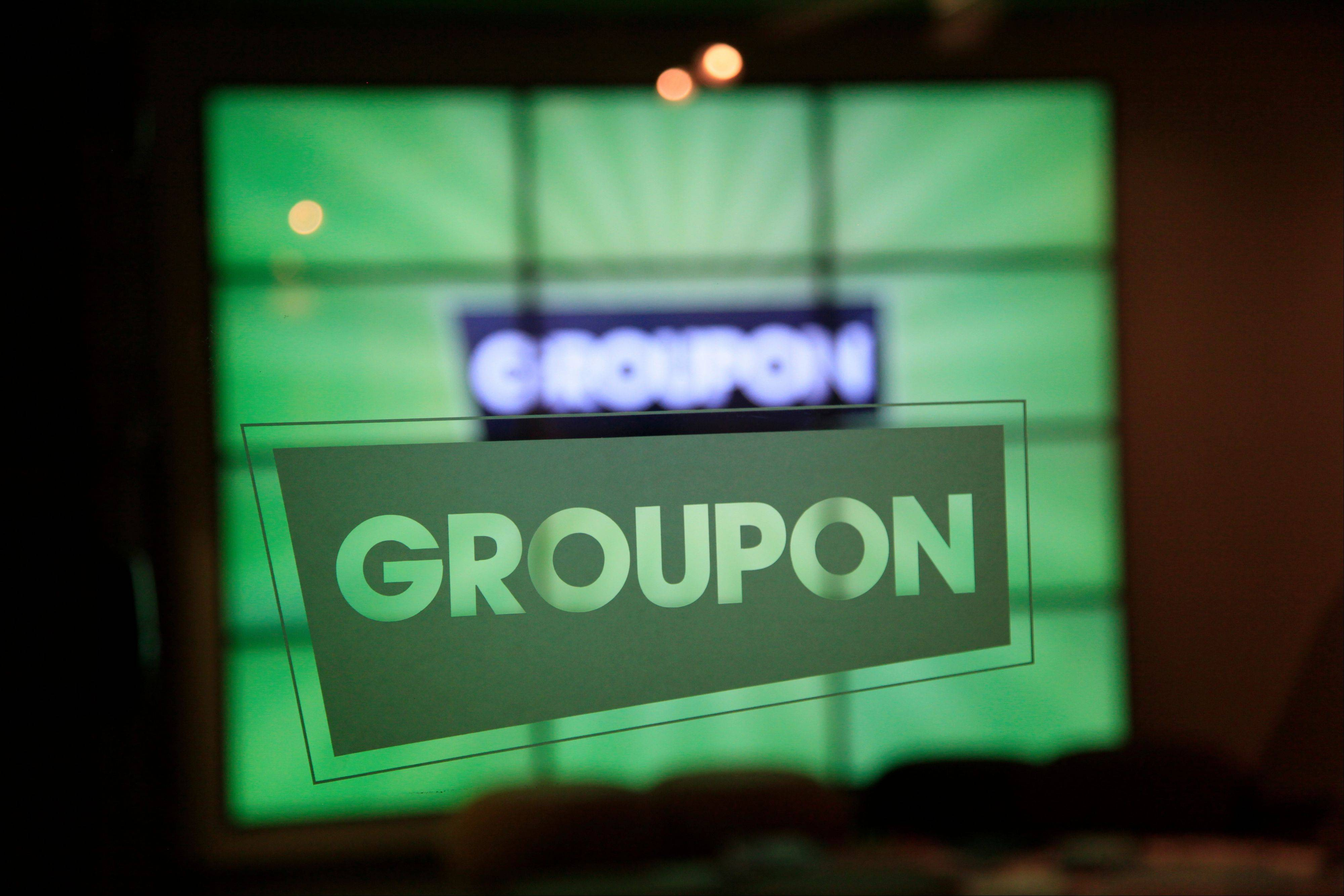 The Groupon logo etched in glass is shown in the lobby of the online coupon company's Chicago offices.