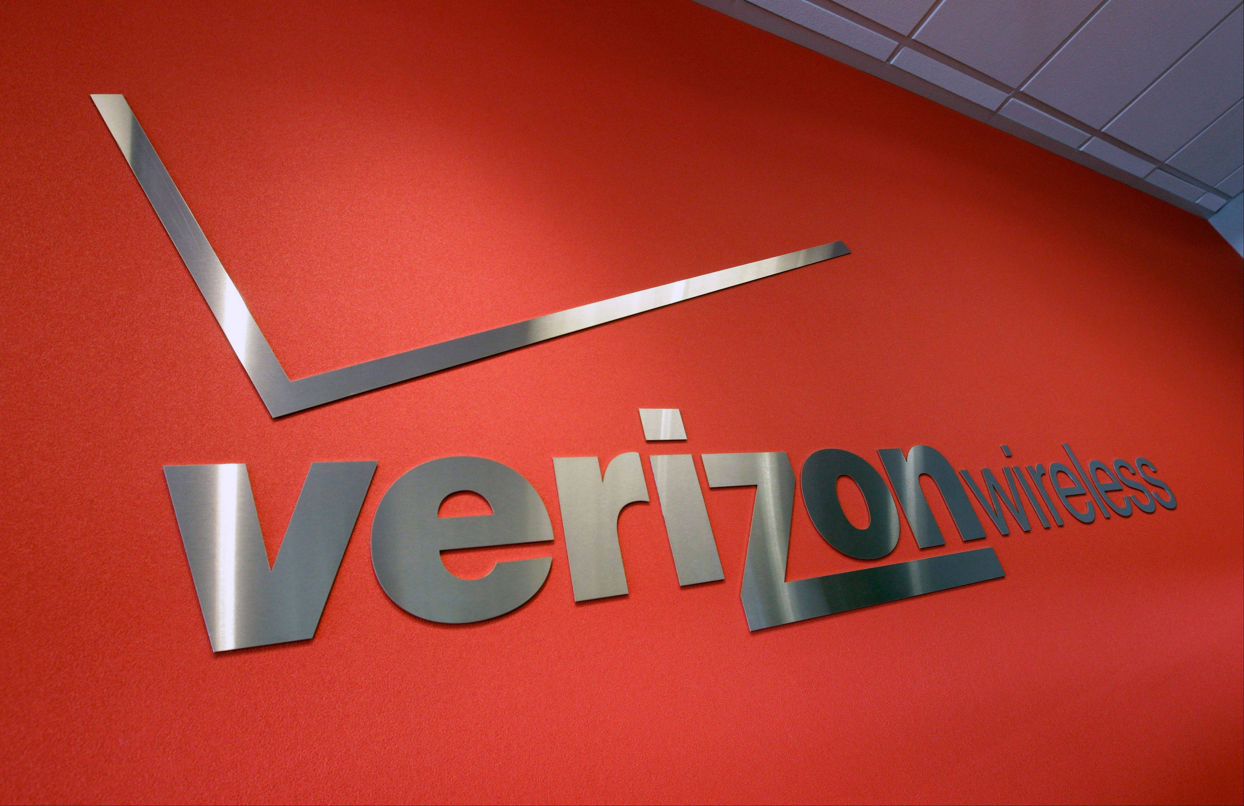 The Justice Department on Thursday approved Verizon Wireless' $3.9 billion purchase of wireless spectrum from four of the nation's largest cable companies but applied conditions to the deal to protect consumers from reduced competition and higher prices.
