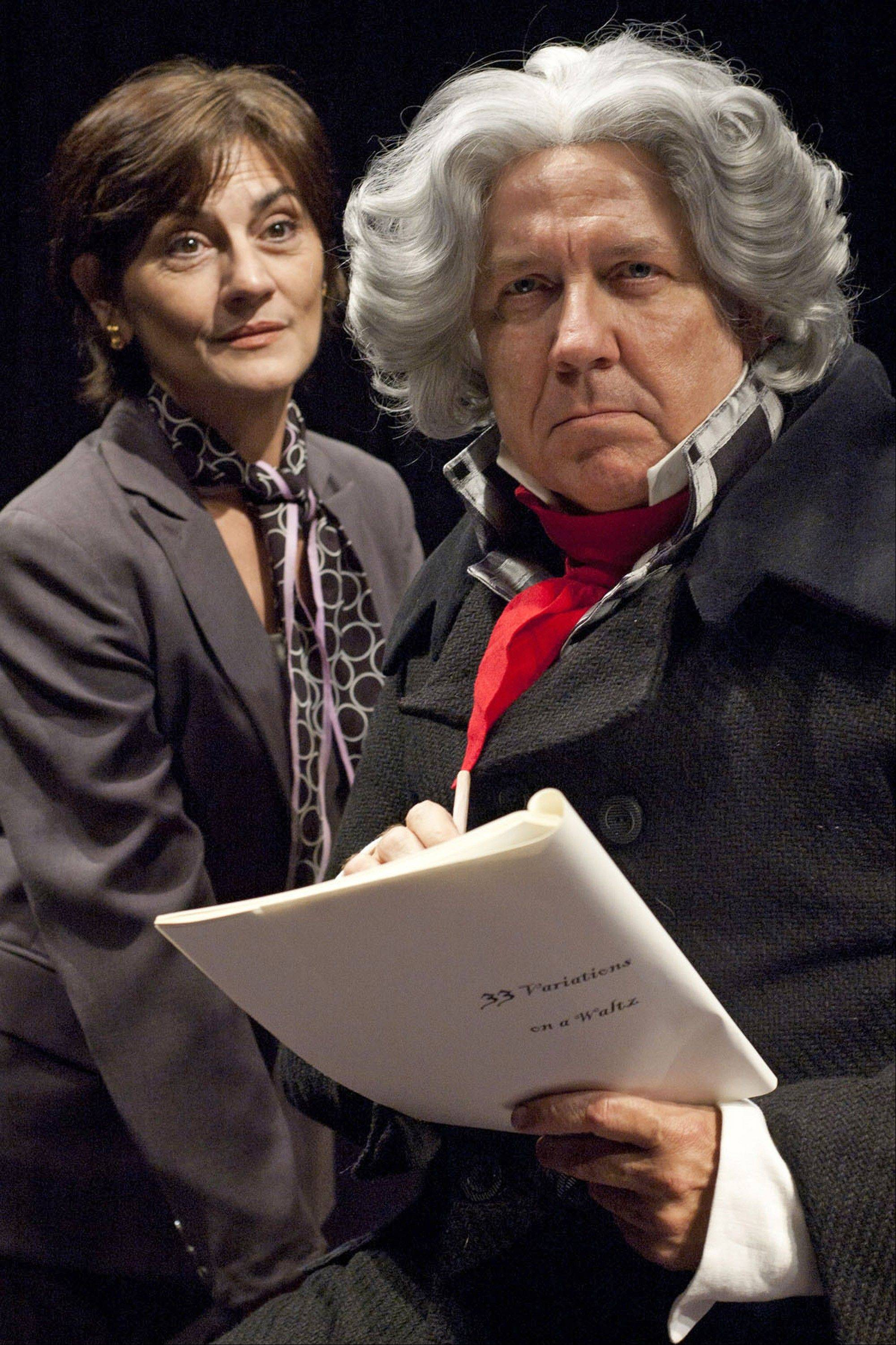 "A modern-day musical scholar (Janet Ulrich Brooks, left) works to figure out why Beethoven (Deerfield's Terry Hamilton) devoted so much time and energy to his ""Diabelli Variations"" in TimeLine Theatre's ""33 Variations."""