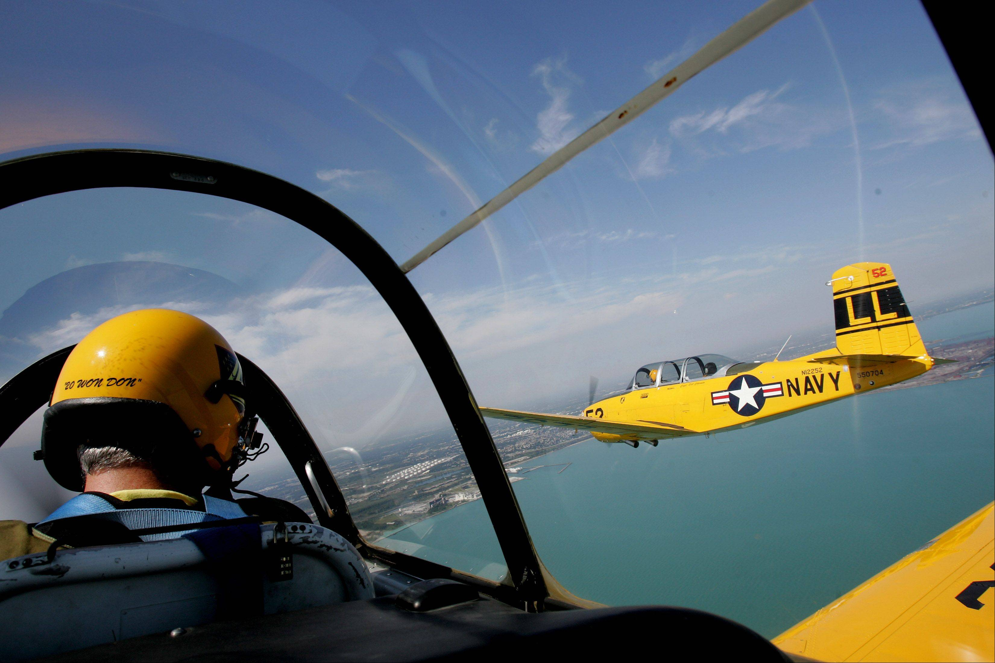Civilian and military aircraft provide displays of aerial feats at the Chicago Air & Water Show.