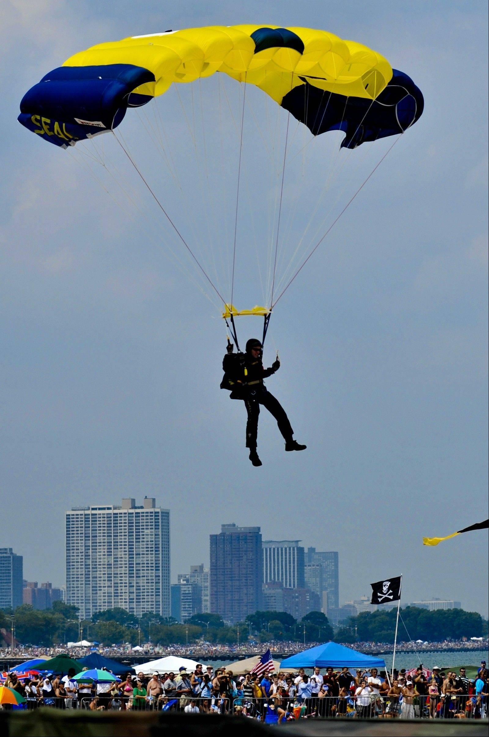 The U.S. Navy's Leap Frog parachute team lands on North Avenue Beach during the Chicago Air & Water Show.