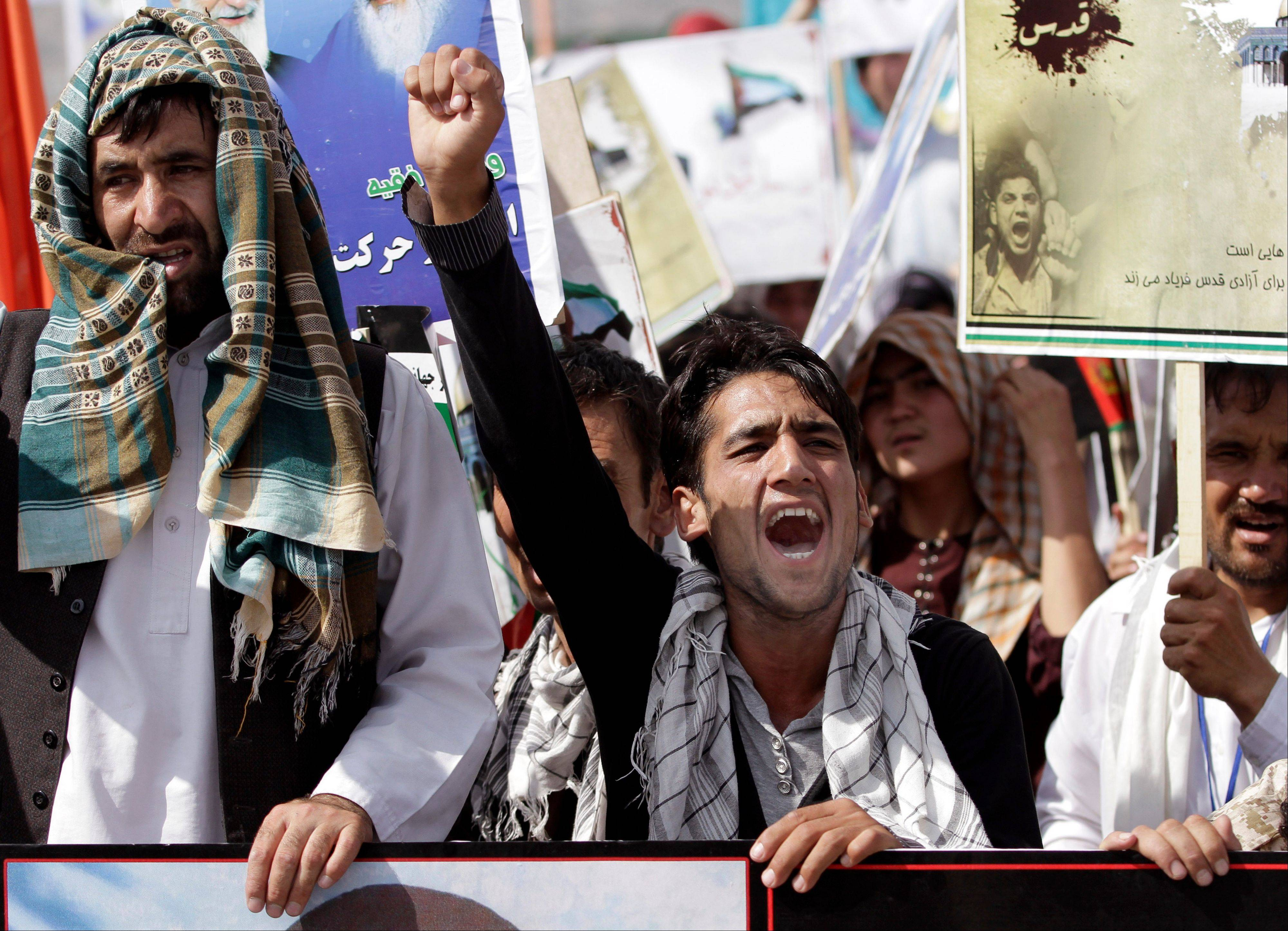 Afghan men shout anti-Israel slogans during a protest Friday in Kabul.